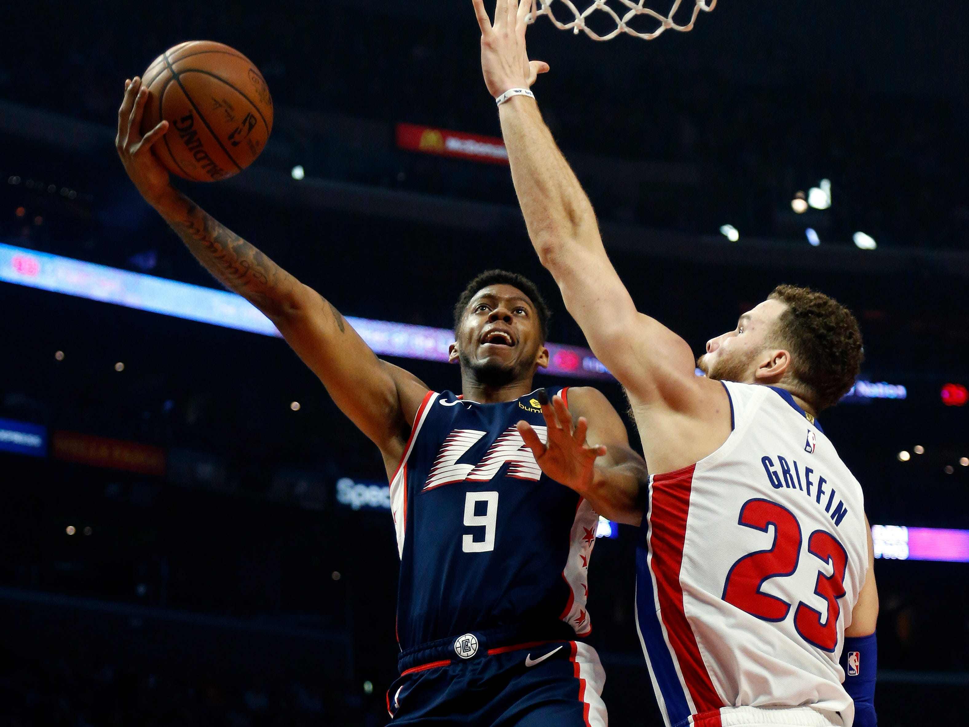 Los Angeles Clippers' Tyrone Wallace shoots against Detroit Pistons' Blake Griffin during the first half Saturday, Jan. 12, 2019, in Los Angeles.