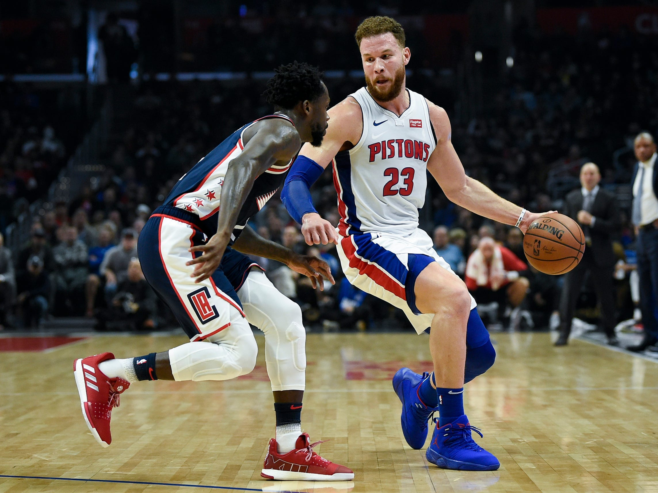 Pistons forward Blake Griffin handles the ball while Clippers guard Patrick Beverley defends during the first half on Jan. 12, 2019, in Los Angeles.