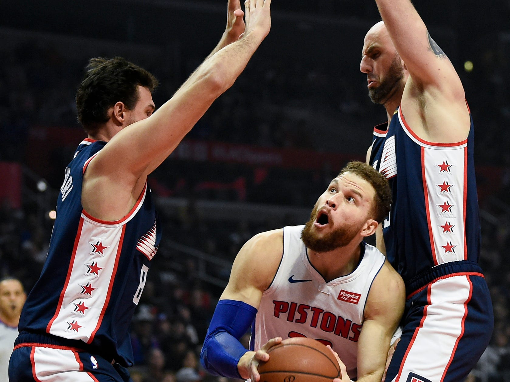 Pistons forward Blake Griffin drives to the basket between Clippers forward Danilo Gallinari, left, and center Marcin Gortat during the first quarter on Saturday, Jan. 12, 2019, in Los Angeles.