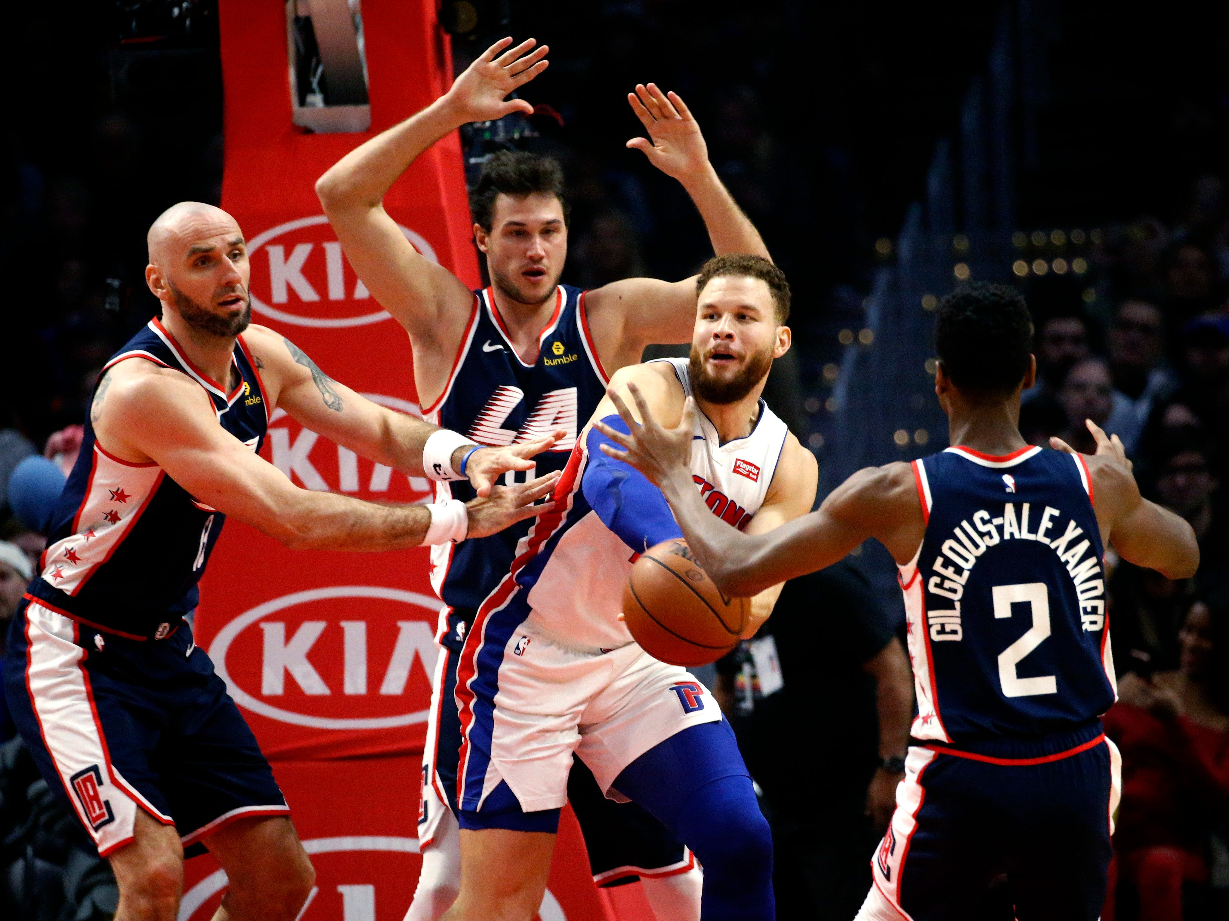 Pistons forward Blake Griffin, center, passes the ball while pressured by the Clippers' Danilo Gallinari, second from left, and Marcin Gortat, left, during the first half on Jan. 12, 2019, in Los Angeles.