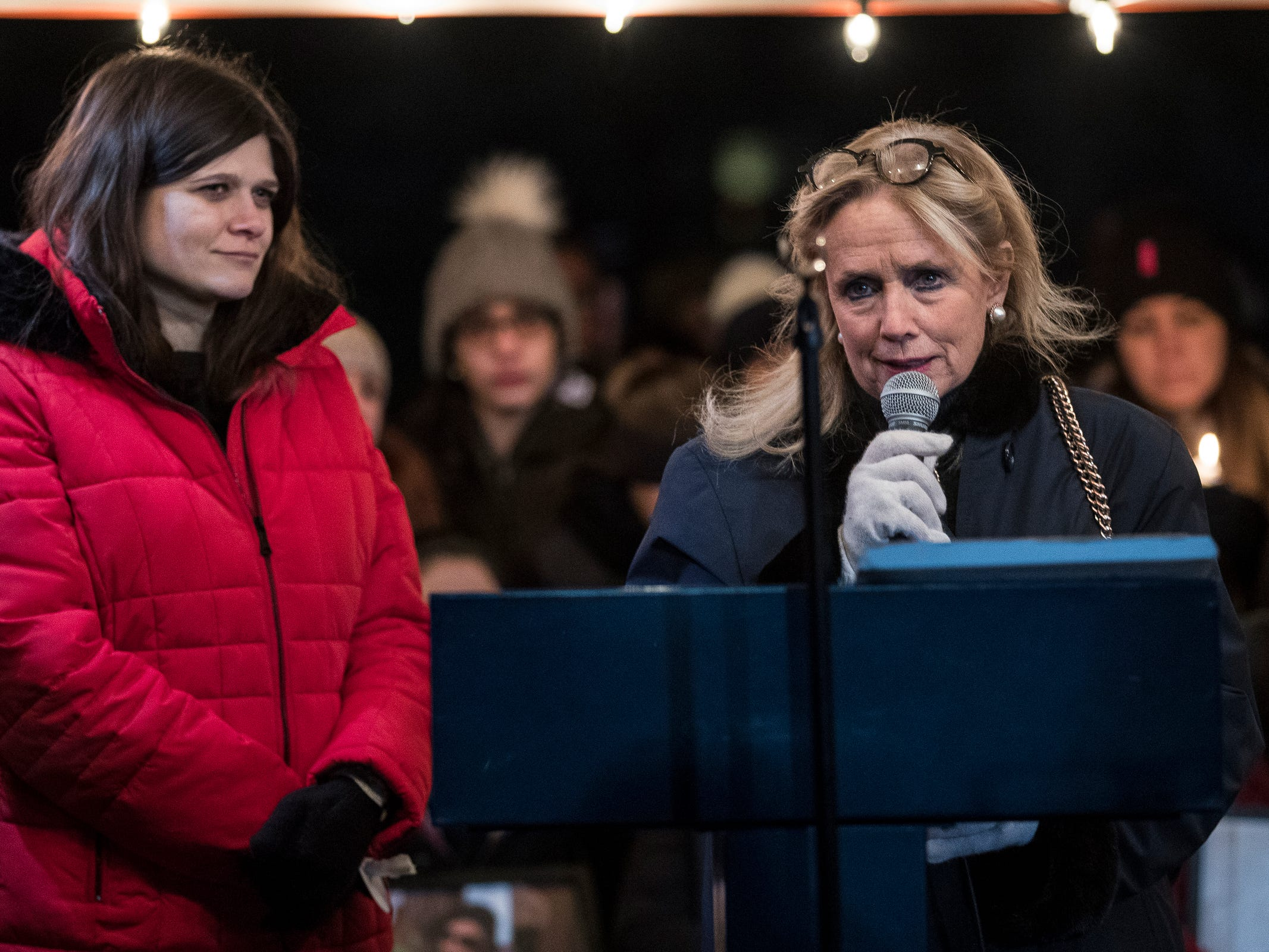 Congresswoman Debbie Dingell speaks next to Congresswoman Haley Stevens during a candlelight vigil for the Abbas family at the Ford Field Park in Northville Friday, Jan. 11, 2019.