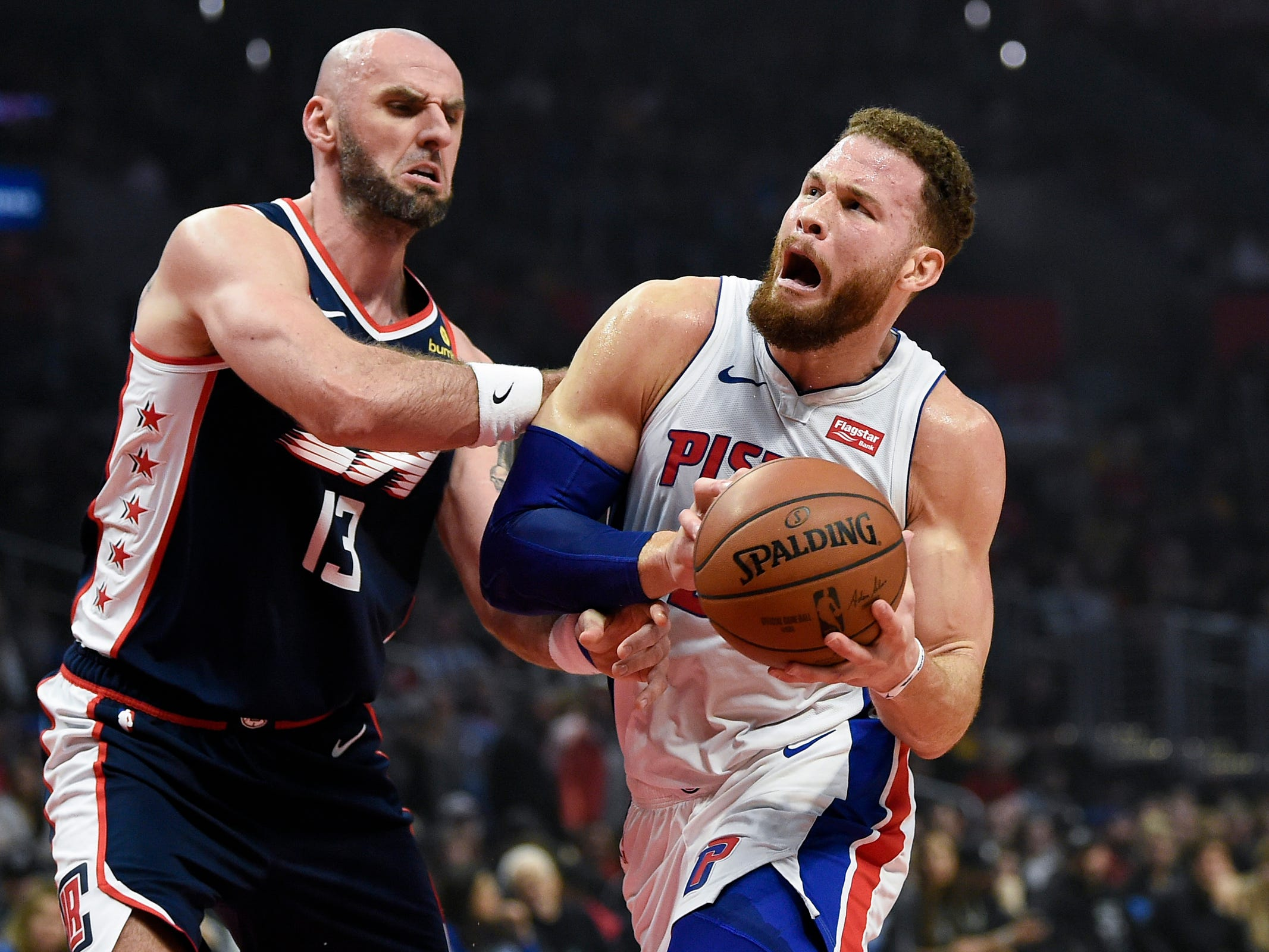Detroit Pistons forward Blake Griffin drives to the basket while Los Angeles Clippers center Marcin Gortat defends during the first quarter at Staples Center, Jan. 12, 2019 in Los Angeles.