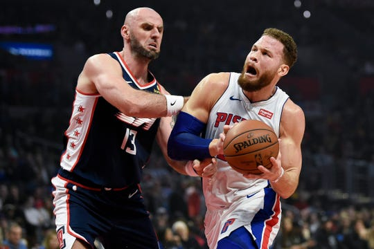 Blake Griffin drives to the basket while Clippers center Marcin Gortat defends in the first quarter at Staples Center on Saturday.