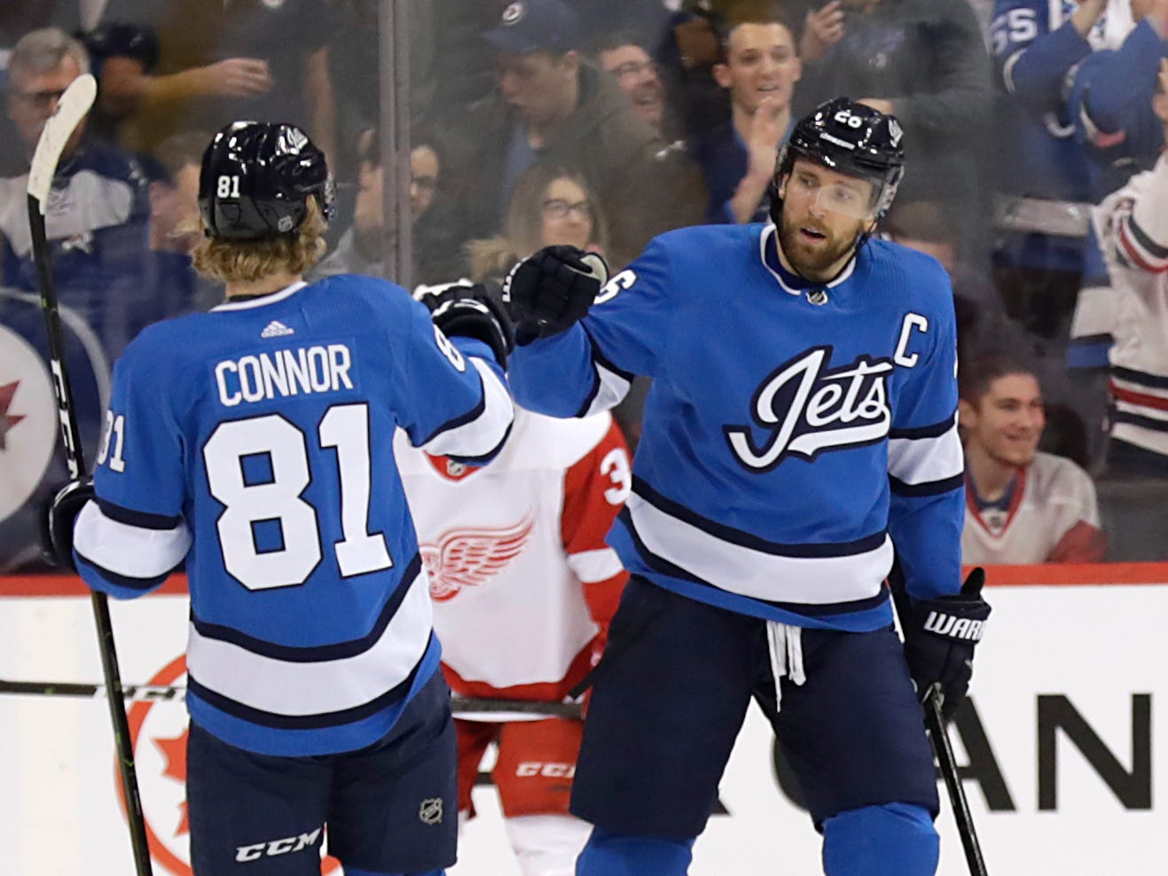 Winnipeg Jets right wing Blake Wheeler, right, celebrates his first-period goal with Kyle Connor against the Detroit Red Wings at Bell MTS Place, Jan. 11, 2019 in Winnipeg.