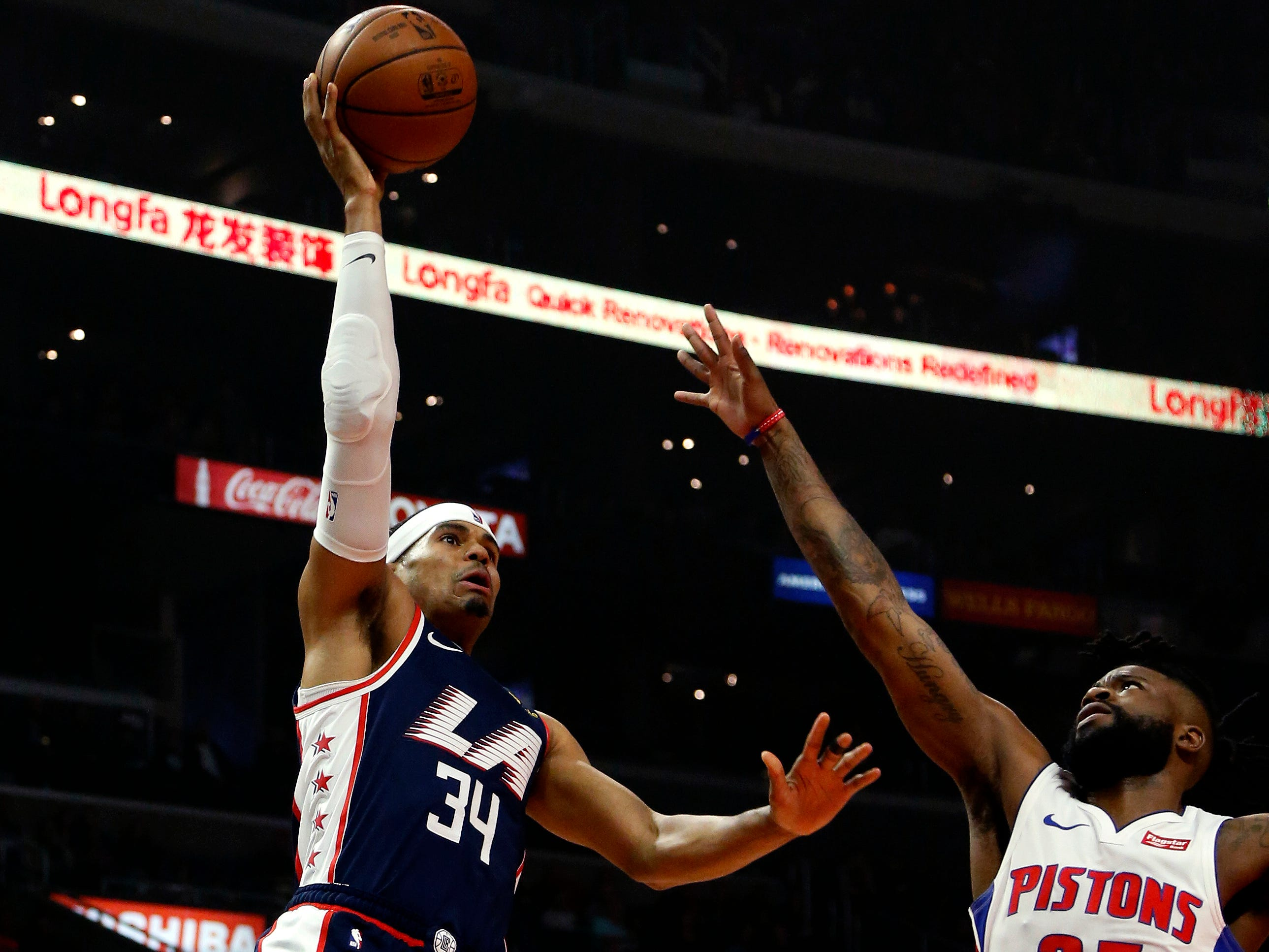 Clippers forward Tobias Harris shoots against Pistons guard Reggie Bullock during the first half Jan. 12, 2019, in Los Angeles.