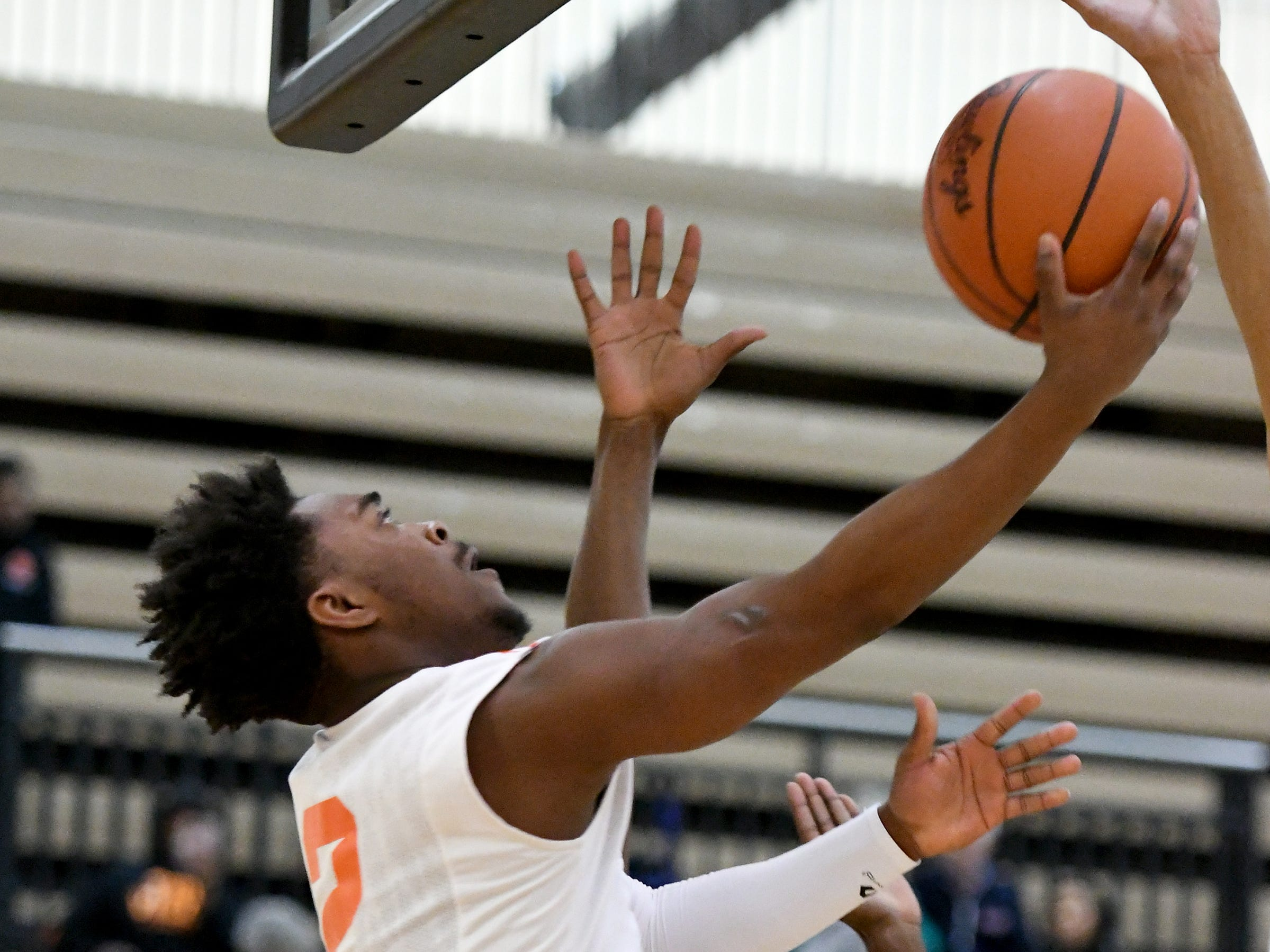 Belleville High School's Lorenzo Wright puts in a reverse layup during the first quarter.