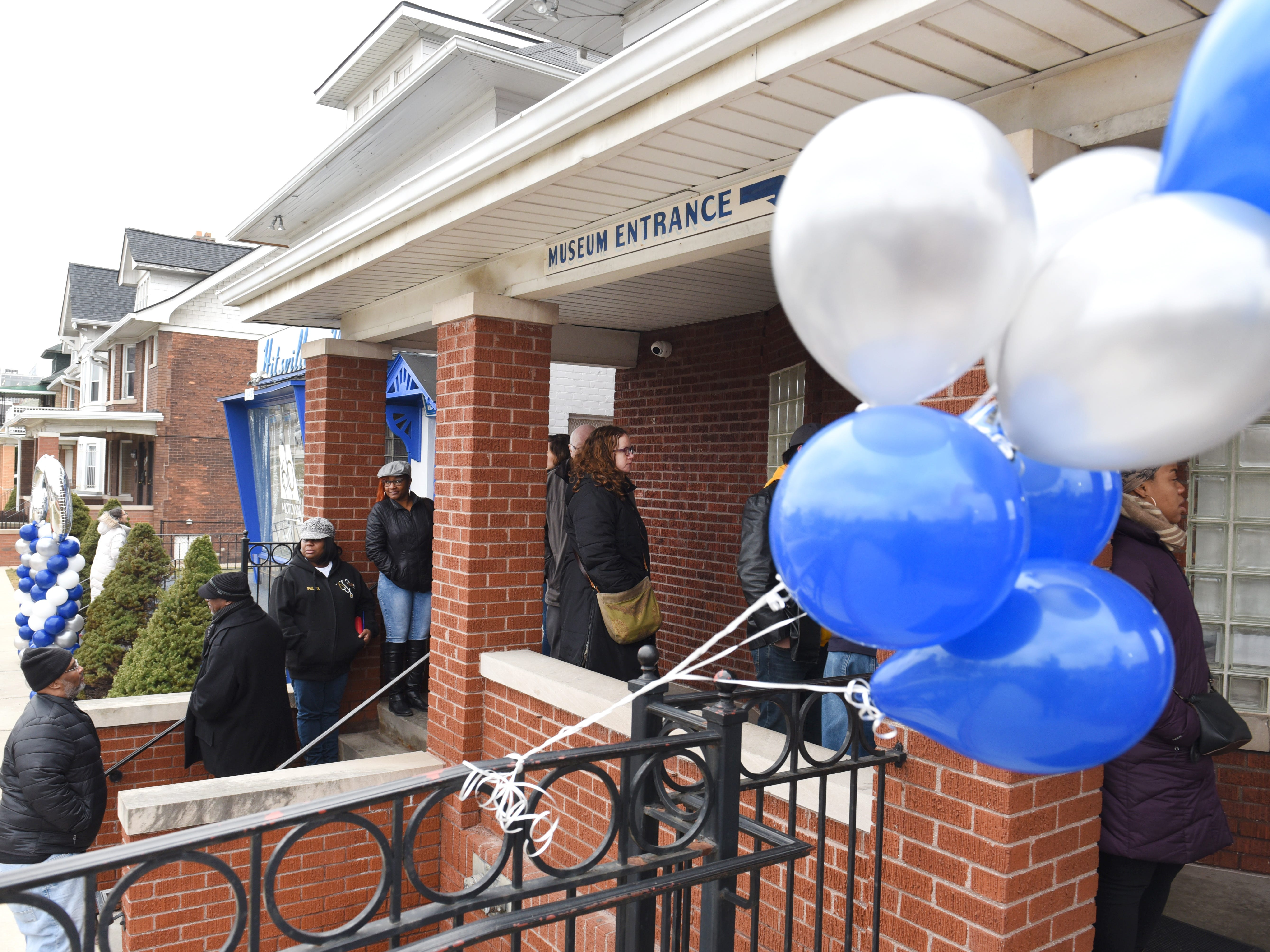 People gather outside the Motown Museum in Detroit as Hitsville USA celebrates the unveiling of never-before-seen artifacts from the founding of Motown Records in honor of its 60th anniversary.