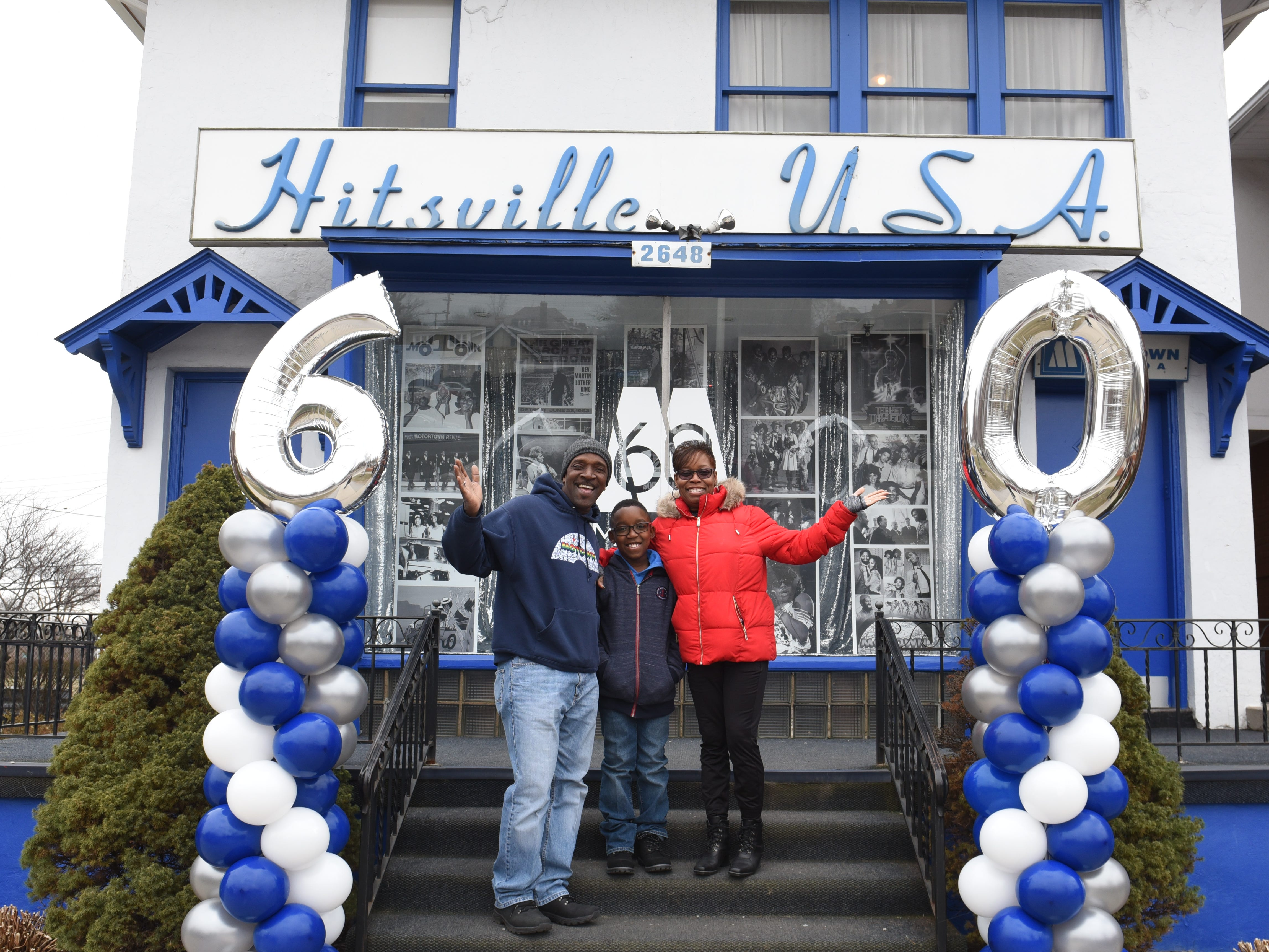 Steve Thomas of Oak Park, with his son DeMarco, 10, and wife Lisette, smile and wave outside the Motown Museum on Saturday, Jan. 12, 2019.