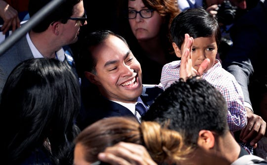 Former San Antonio Mayor and Housing and Urban Development Secretary Julian Castro, center, greets supporters during an event where he announced his decision to seek the 2020 Democratic presidential nomination on Saturday.