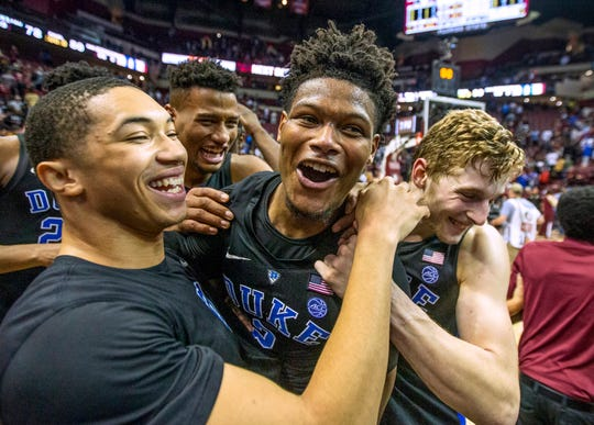 Duke guard Jordan Goldwire, left, and forward Jack White, right, celebrate with Cam Reddish after Reddish scored the game-winning jump shot against Florida State with less than a second left in the second half Saturday. Duke defeated Florida State 80-78.