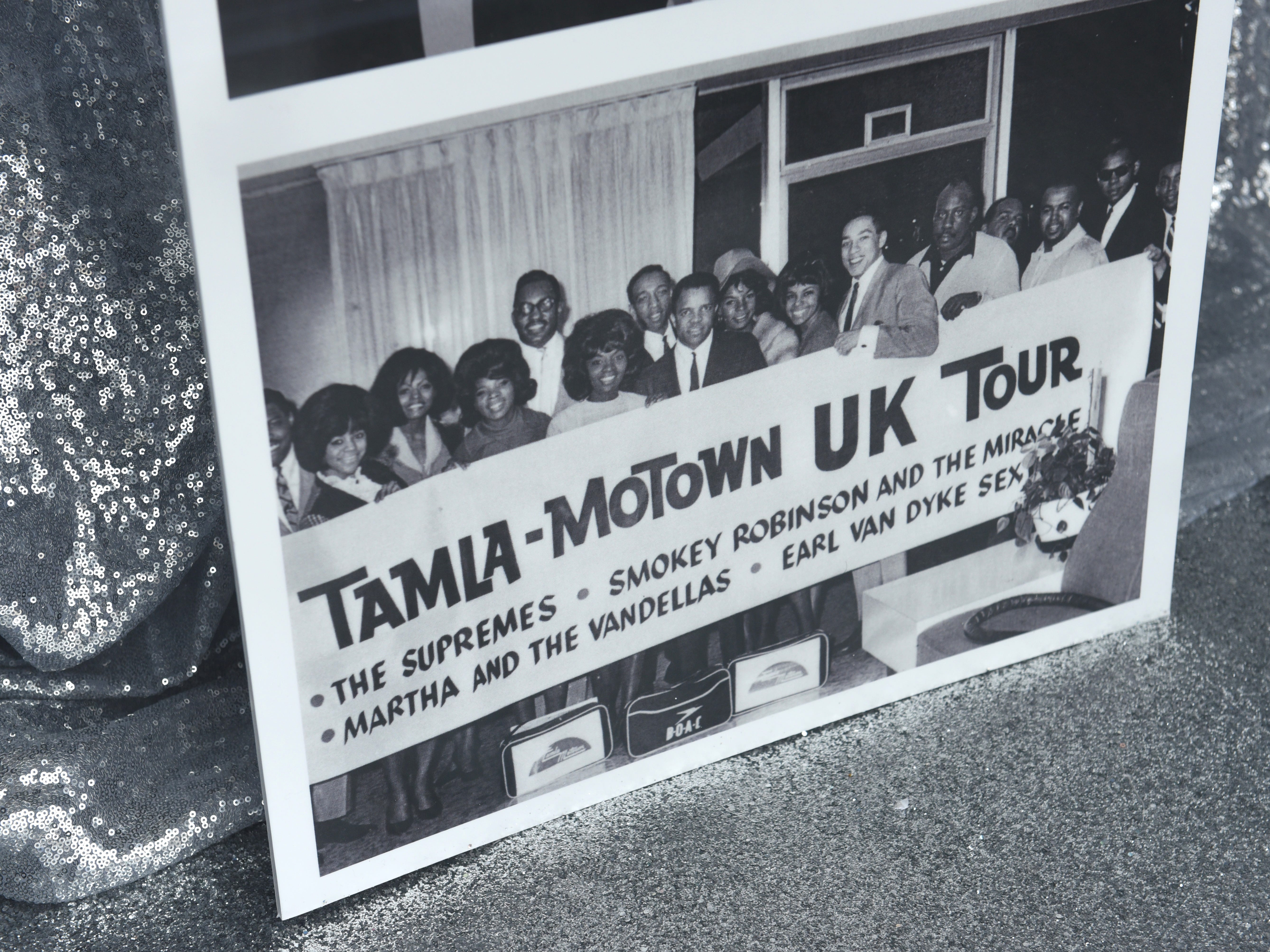 Historical photographs in a display case chronicle famous Motown artist.