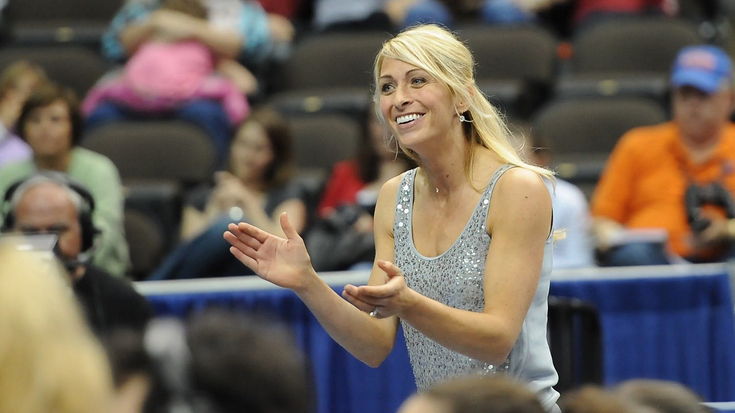 Rhonda Faehn, who left USA Gymnastics during the fallout from the Larry Nassar sex scandal, was fired by UM a day after news of her hiring broke