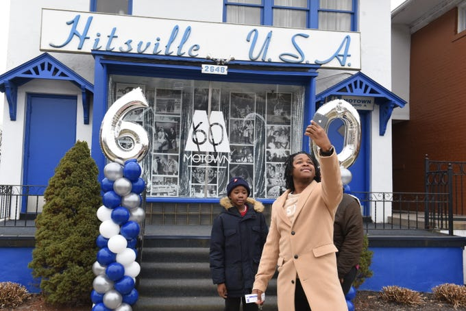 People take selfies outside Hitsville USA as The Motown Museum celebrates  the unveiling of never-before-seen artifacts on Saturday, Jan. 12, 2019.