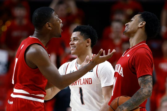 Maryland guard Anthony Cowan Jr. smiles near Indiana guards Aljami Durham, left, and Devonte Green after Cowan was fouled while driving the ball during the second half Friday. Maryland won 78-75.