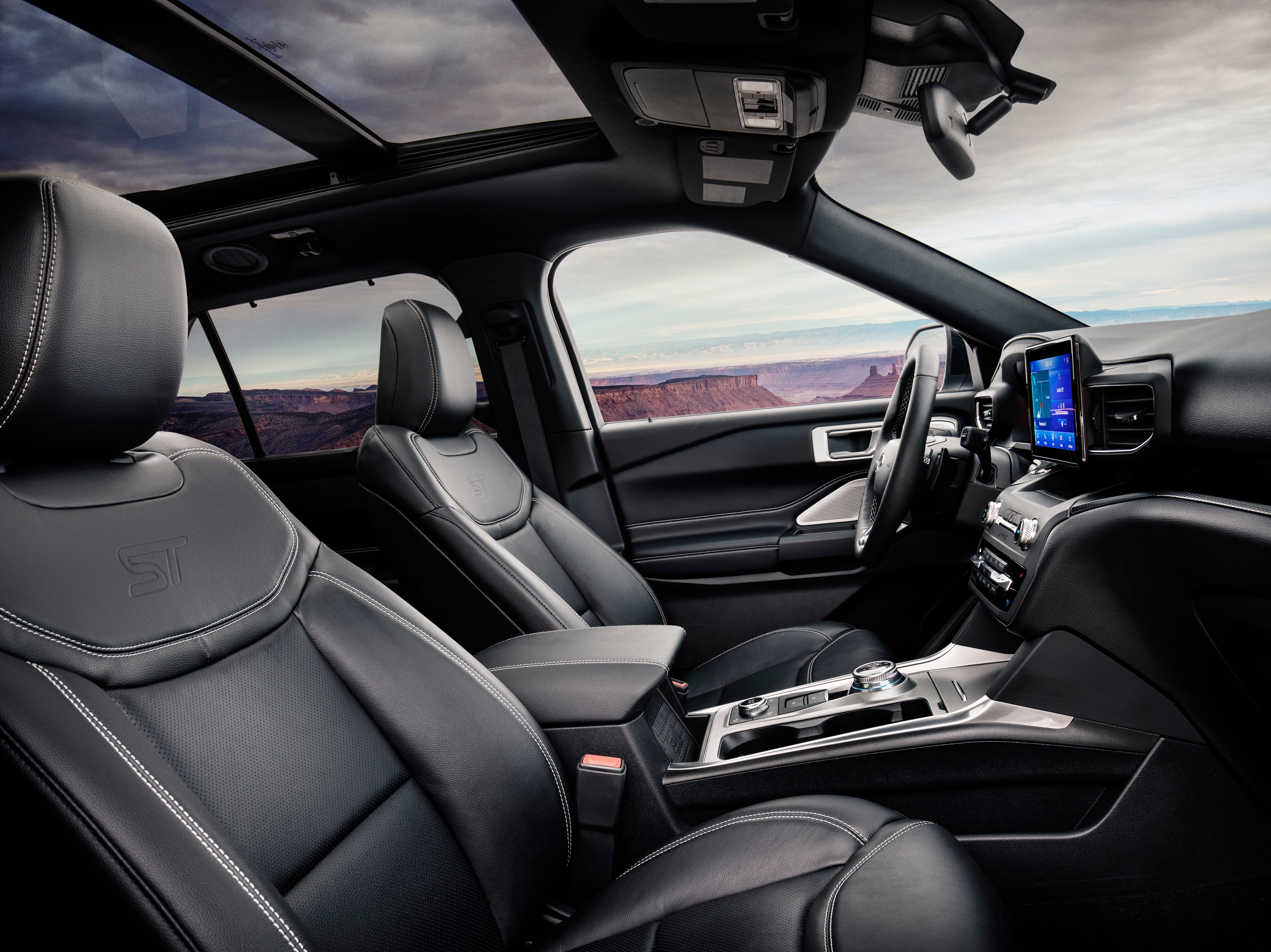"""""""Inside the 2020 Ford Explorer ST, a 12.3-inch all-digital instrument cluster is standard. A flat-bottomed, heated steering wheel embossed with an ST logo and unique floor mats are subtle cues exclusive to Explorer ST. Leather sport bucket seats with micro-perforation, City Silver accent stitching and ST logo complete the sporty feel."""""""