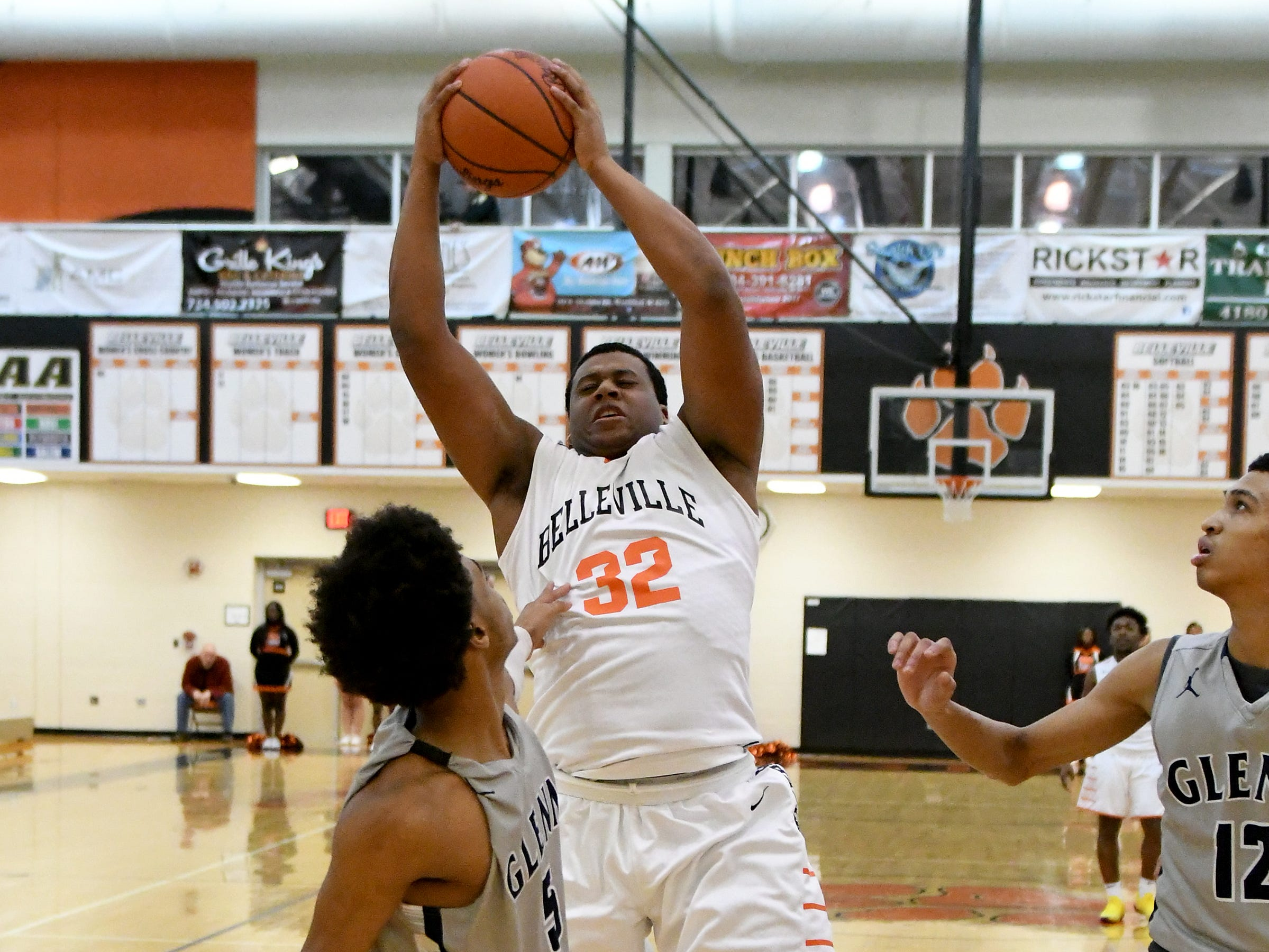 Belleville High School's Jalen Hunt hauls down a first quarter rebound against John Glenn High School.