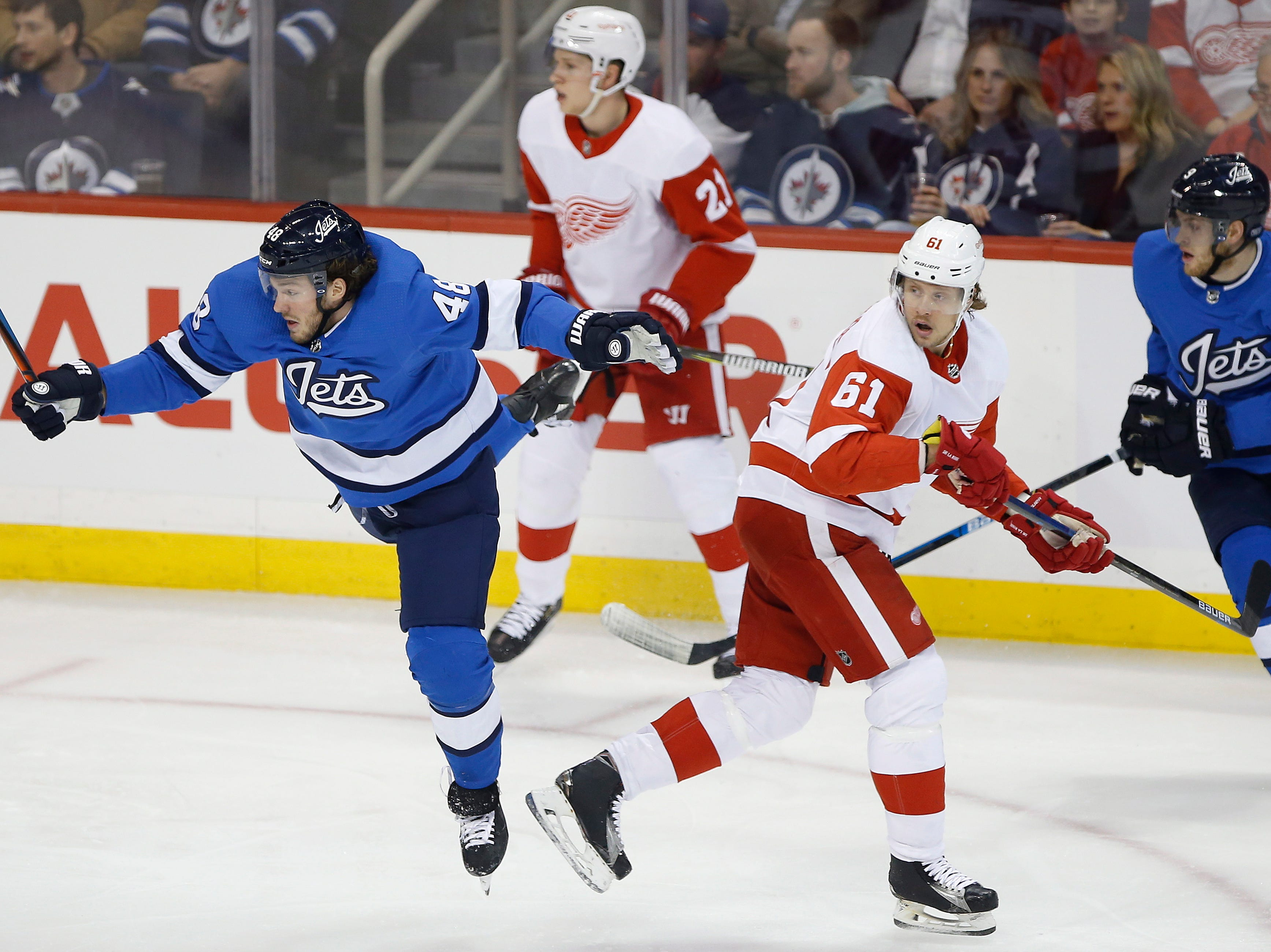Winnipeg Jets' Brendan Lemieux (48) and Detroit Red Wings' Jacob de la Rose (61) collide during the first period.