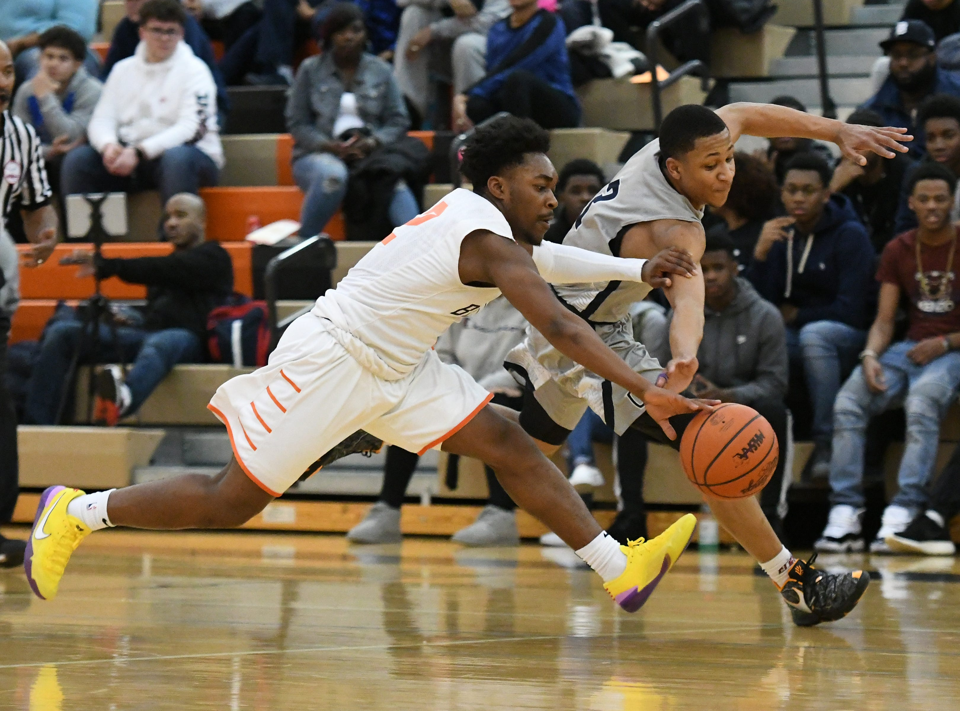 Belleville High School's Lorenzo Wright, left battles for a loose ball with John Glenn High School's Joe Moon IV, during the second quarter.