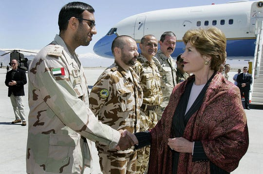 U.S. First Lady Laura Bush is greeted by members of the coalition military forces upon her arrival at Bagram Air Base north of Kabul, 30 March 2005.