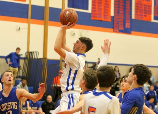 Xander Burch puts up a shot for Thomas A. Edison in boys basketball against Lansing on Jan. 11, 2019 in Elmira Heights.
