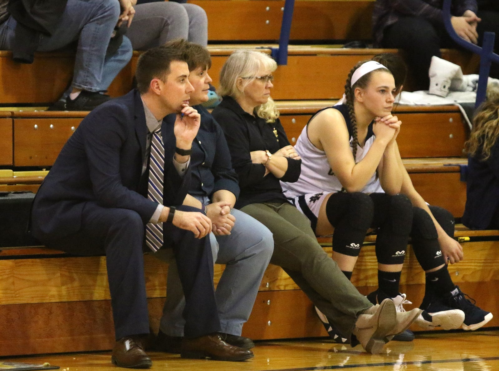 Max Young, left, coaches the Elmira Notre Dame girls basketball team against Bainbridge-Guilford on Jan. 12, 2019 in Southport.