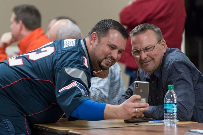 """Richard Morris Jr., left, takes a selfie with Mark Grace, a retired Major League Baseball Infielder for the Arizona Diamondbacks and Chicago Cubs, during an autograph signing at the """"Night of Memories"""" event held at Vanderburgh 4-H Center in Evansville, Ind., Saturday, Jan. 12, 2019."""