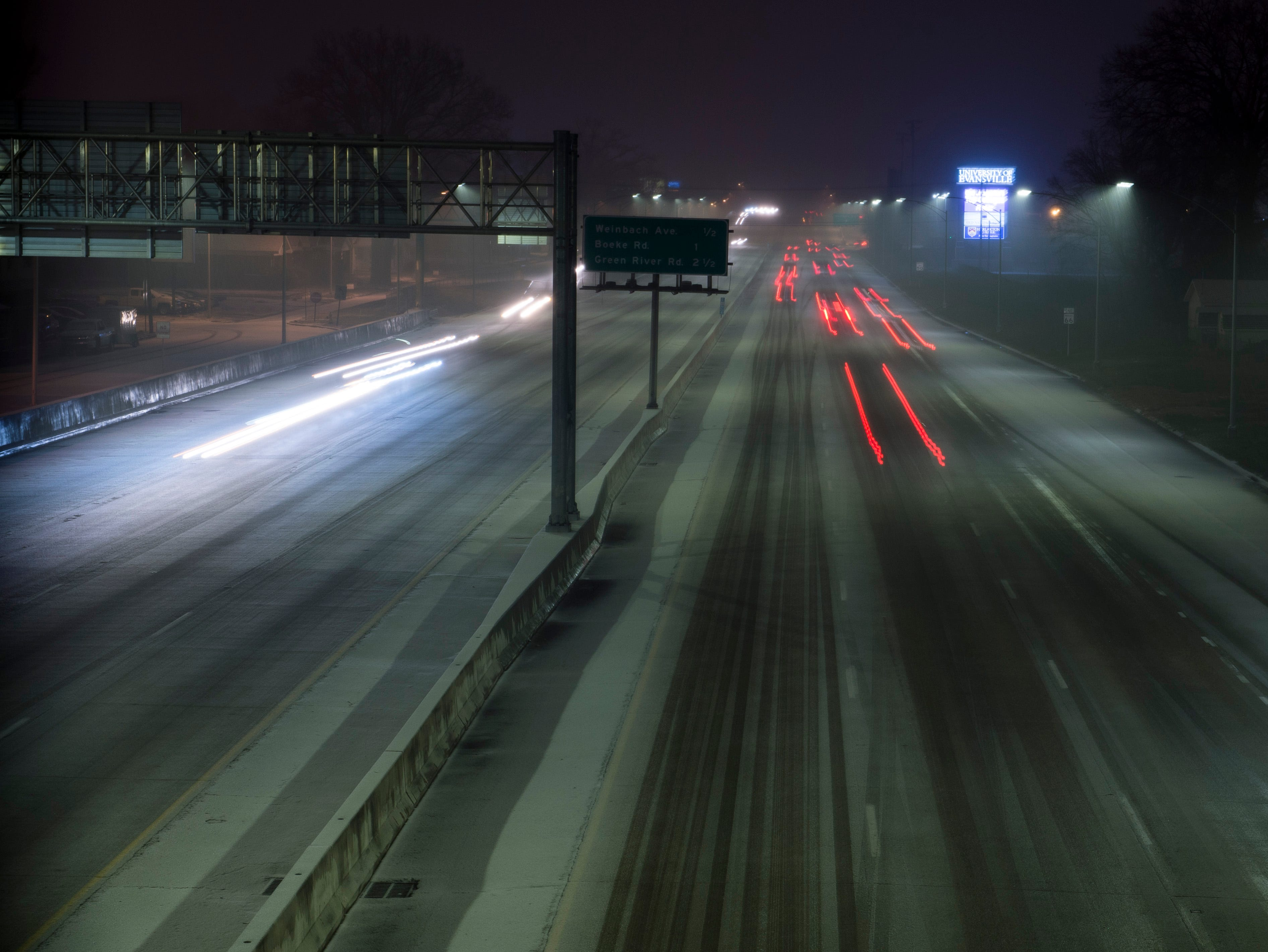 Cars drive East down the Lloyd Expressway as snow begins to accumulate on the road Friday evening Jan. 11, 2019.