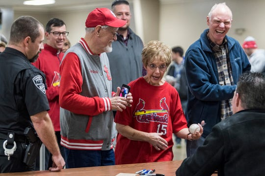 "Mary Monroe, center right, tells Jim Edmonds, a retired Major League Baseball player and current broadcaster for Fox Sports Midwest, that she is a huge fan of him during the ""Night of Memories"" autograph signing at Vanderburgh 4-H Center in Evansville, Ind., Saturday, Jan. 12, 2019. Monroe's husband, John Monroe, center left, took pictures of her talking to Edmonds and laughed along with them."