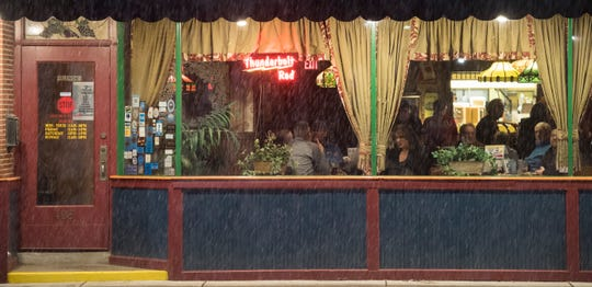 Customers at Turoni's Pizzery & Brewery on North Main Street enjoy the warmth of the inside as snow fall on the Tri-State Friday evening Jan. 11 ,2019.