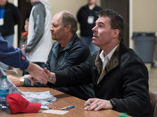 "Jim Edmonds, a retired Major League Baseball player and current broadcaster for Fox Sports Midwest, shakes hands with a fan before signing autographs during the ""Night of Memories"" event held at Vanderburgh 4-H Center in Evansville, Ind., Saturday, Jan. 12, 2019."