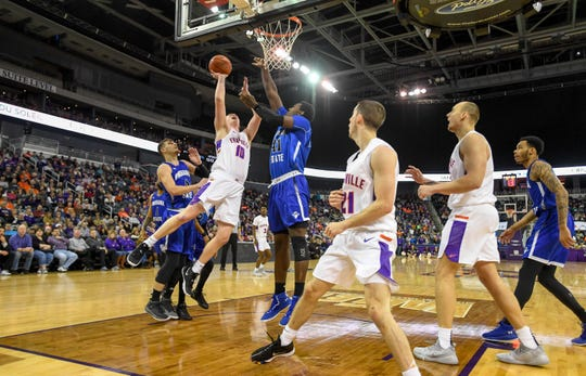 University of Evansville's Evan Kuhlman (10) shoots over Indiana State's Emondre Rickman (41) as the University of Evansville Purple Aces play the Indiana State Sycamores at the Evansville Ford Center Saturday, January 12, 2019.