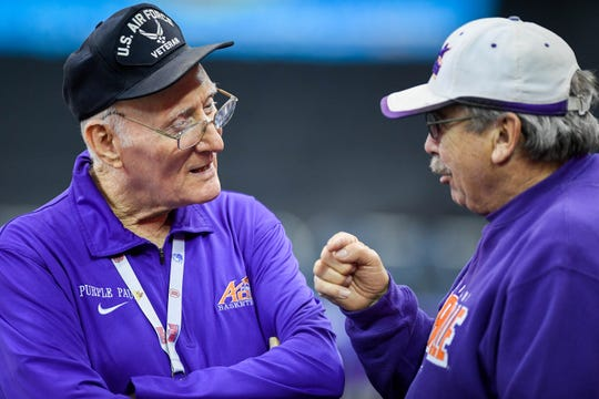 """Aces super fan """"Purple Paul"""" Werner talks over old times with friend Ottis Putler before Saturday's game with Indiana State at the Ford Center, January 12, 2019."""