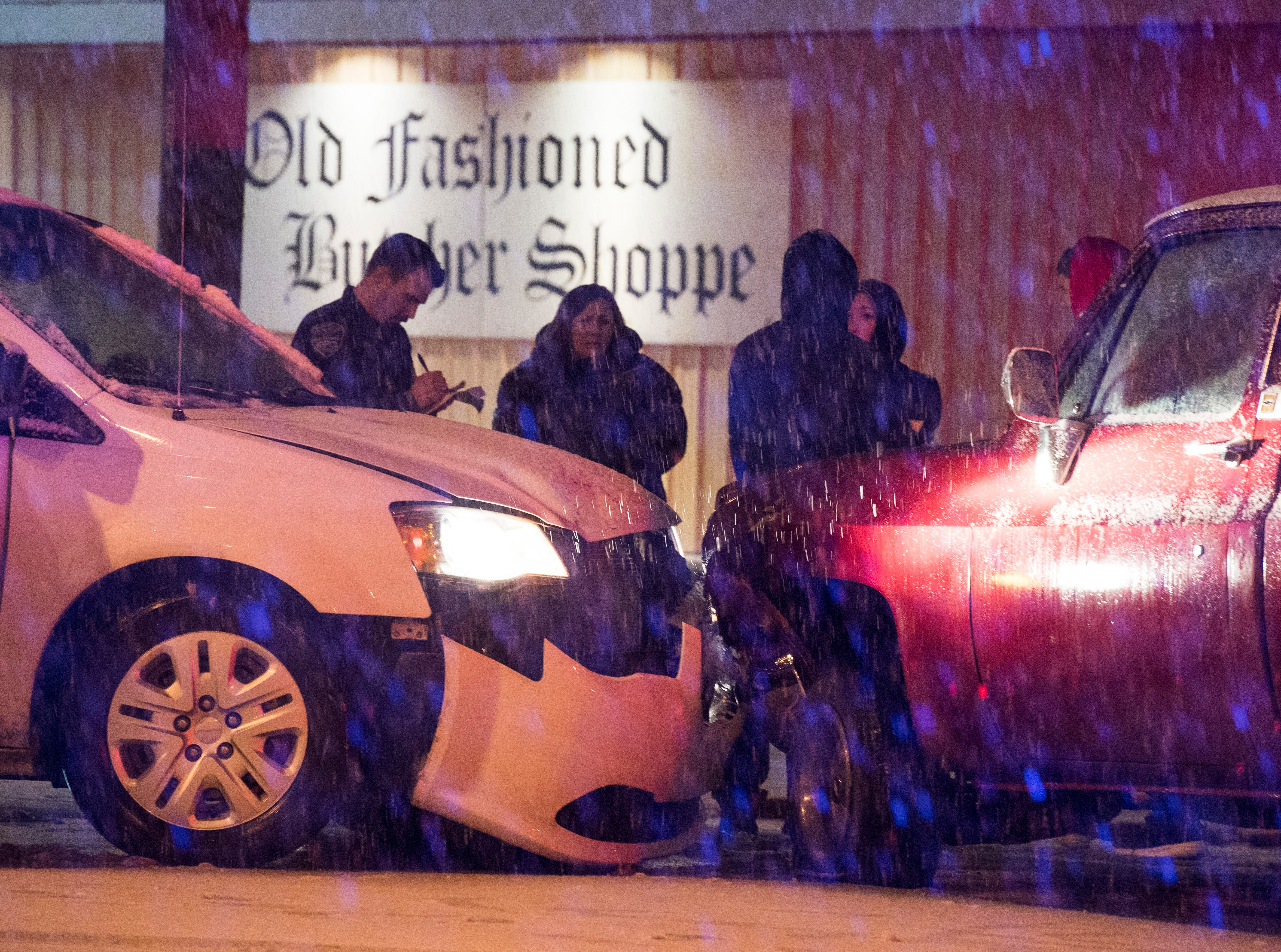 A two vehicle accident at the intersection of Wedeking Drive and Stringtown Road in front of Old Fashioned Butcher Shoppe as snow begins to accumulate on the road Friday evening Jan. 11, 2019.