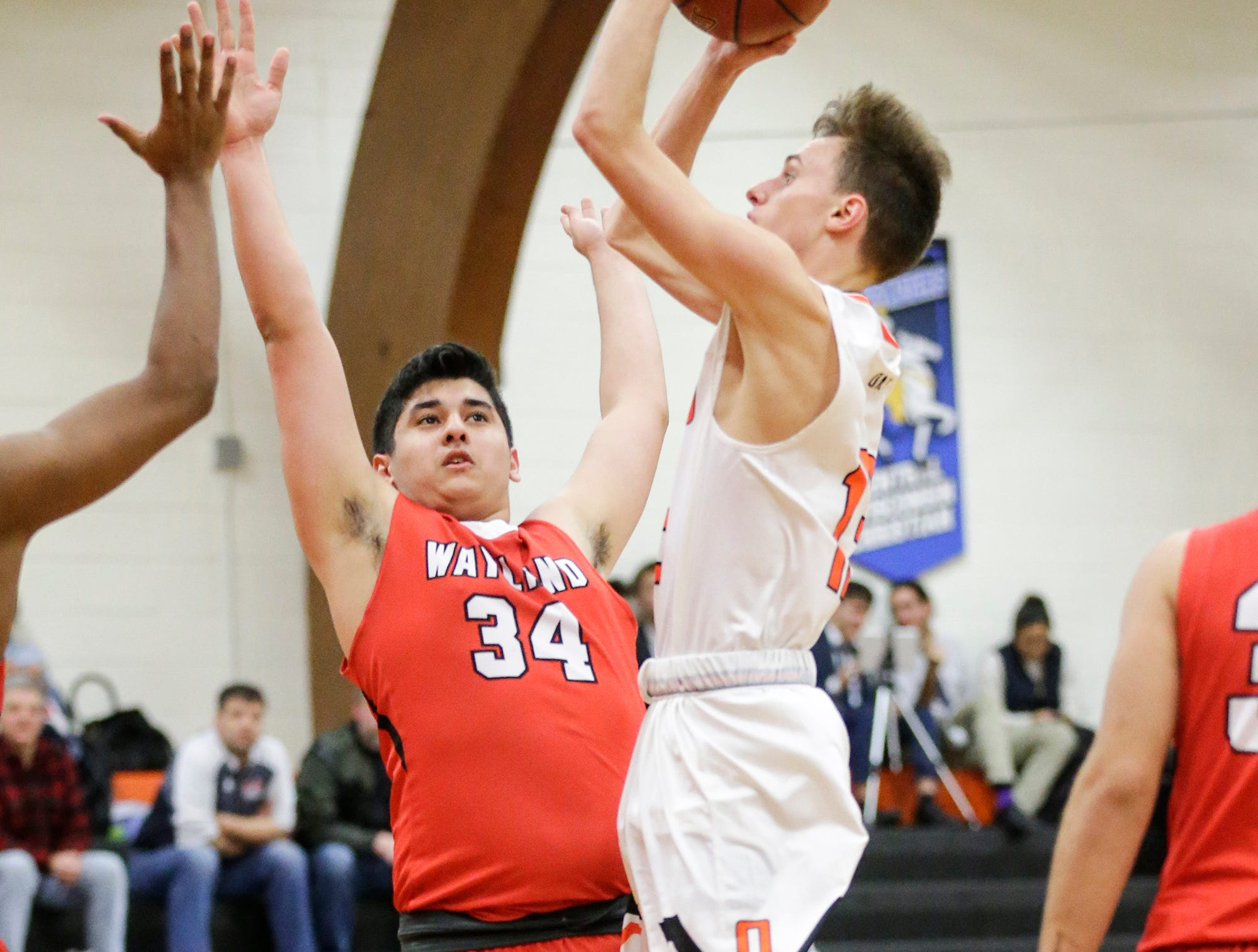 Oakfield High School boys basketball's Tyler Streeter attempts a shot over Wayland Academy's Peter Petrakis January 11, 2019 during their game in Oakfield. Oakfield won the game 56-48. Doug Raflik/USA TODAY NETWORK-Wisconsin