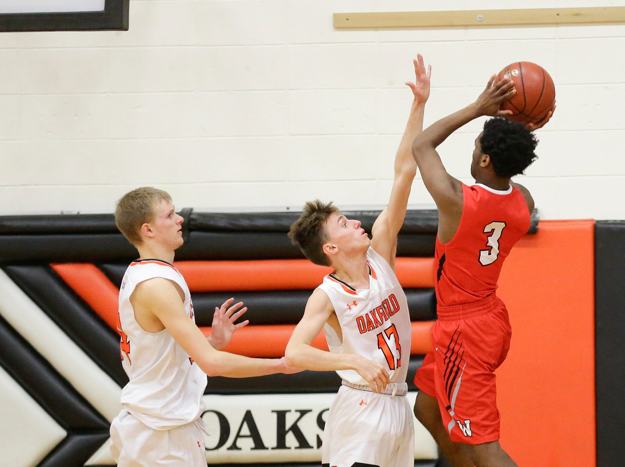Oakfield High School boys basketball's Tyler Streeter defends against Wayland Academy's Jared Sullivan January 11, 2019 during their game in Oakfield. Oakfield won the game 56-48. Doug Raflik/USA TODAY NETWORK-Wisconsin