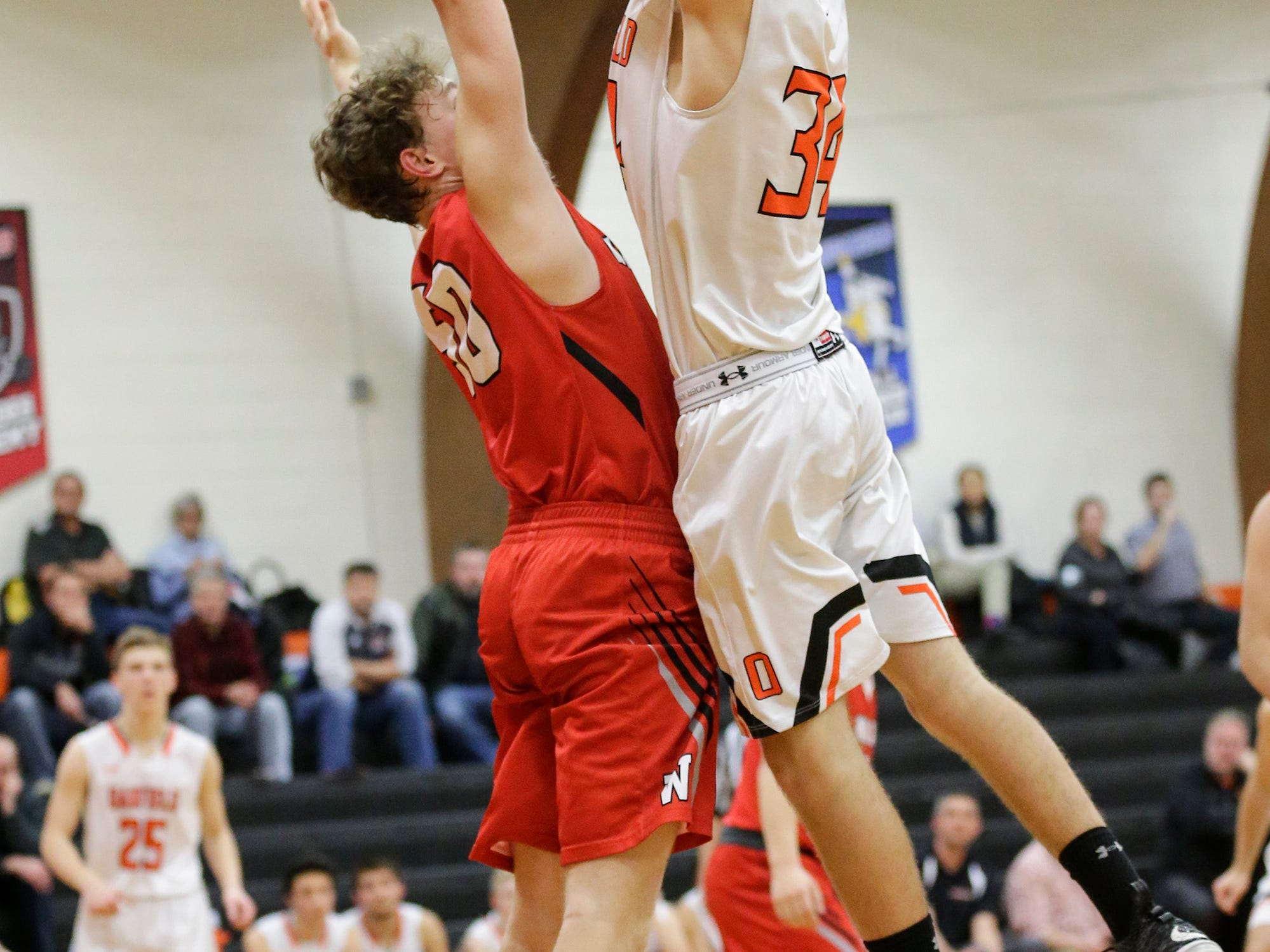 Oakfield High School boys basketball's Jaxson Hofman attemts a shot against Wayland Academy's Adam Rubinchik January 11, 2019 during their game in Oakfield. Oakfield won the game 56-48. Doug Raflik/USA TODAY NETWORK-Wisconsin