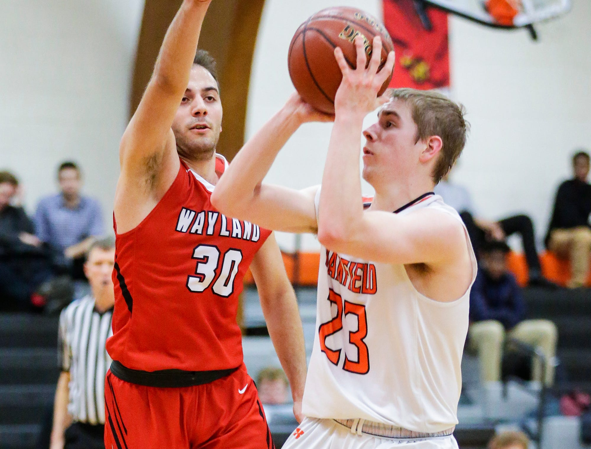 Oakfield High School boys basketball's Max Margelofsky makes this shot against Wayland Academy's Kerem Kocer January 11, 2019 during their game in Oakfield. Oakfield won the game 56-48. Doug Raflik/USA TODAY NETWORK-Wisconsin