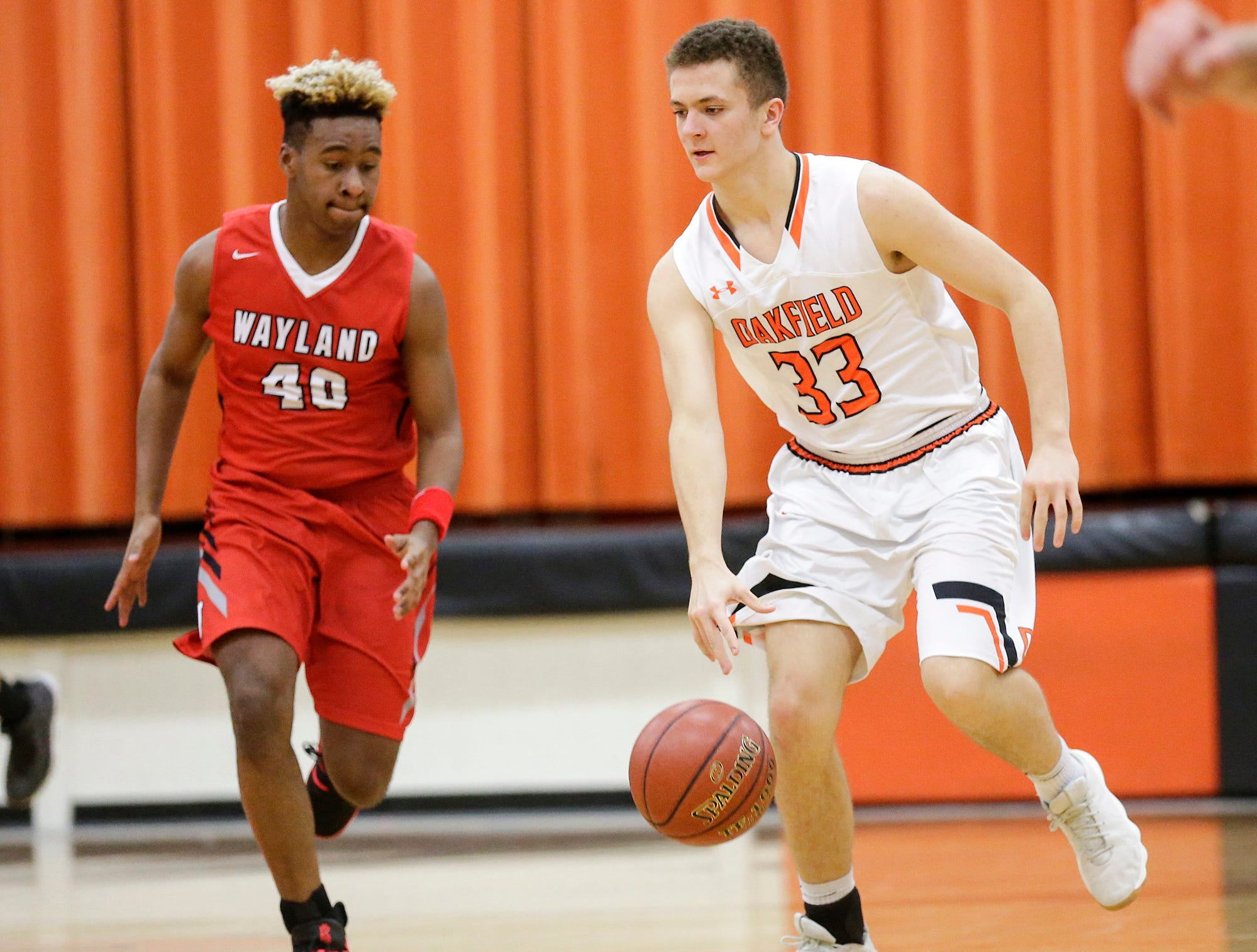 Oakfield High School boys basketball's Bart Bijl works his way down court against Wayland Academy's Mark Todd January 11, 2019 during their game in Oakfield. Oakfield won the game 56-48. Doug Raflik/USA TODAY NETWORK-Wisconsin