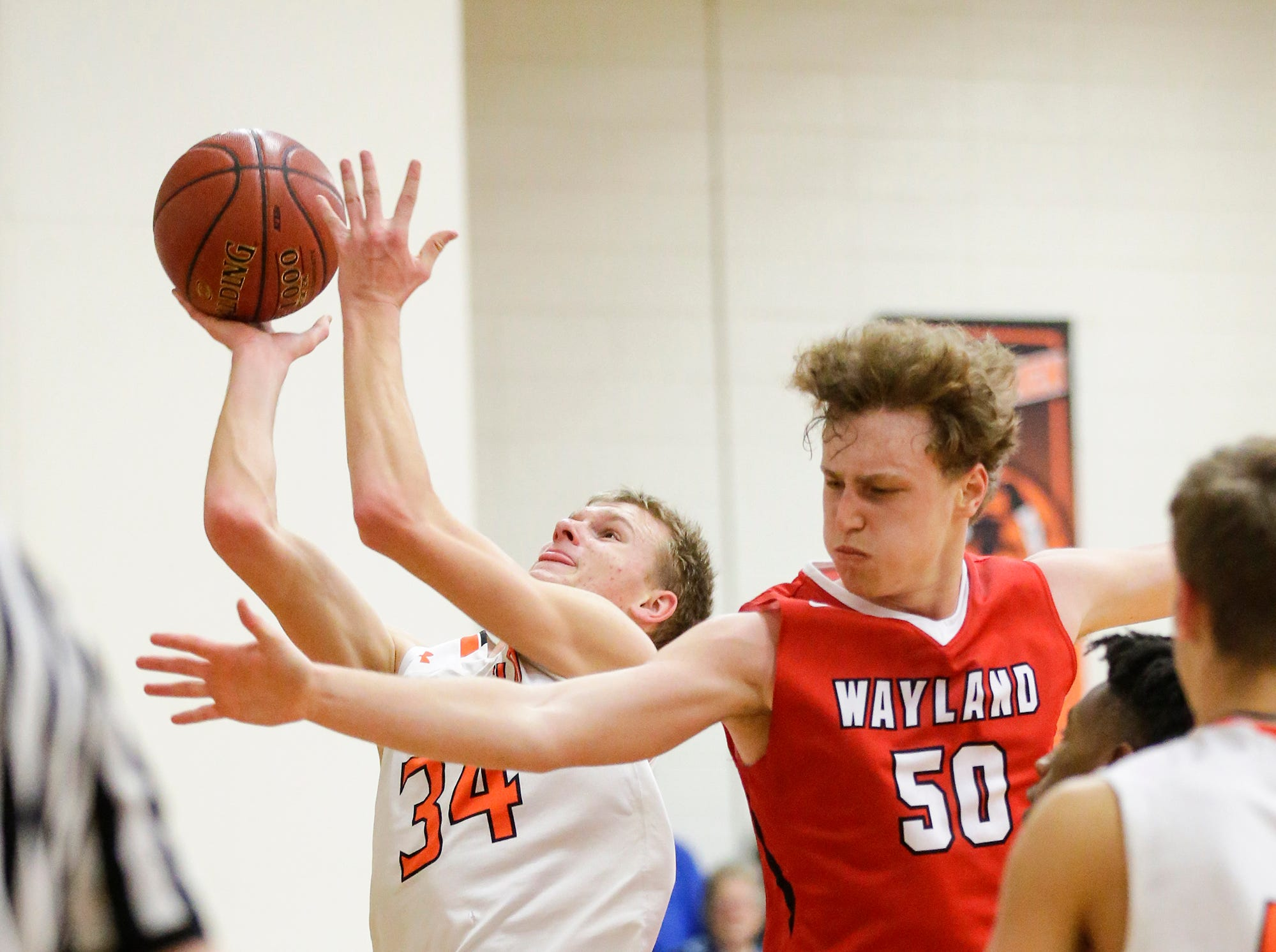 Oakfield High School boys basketball's Jaxson Hofman gets fouled by Wayland Academy's Adam Rubinchik January 11, 2019 during their game in Oakfield. Oakfield won the game 56-48. Doug Raflik/USA TODAY NETWORK-Wisconsin