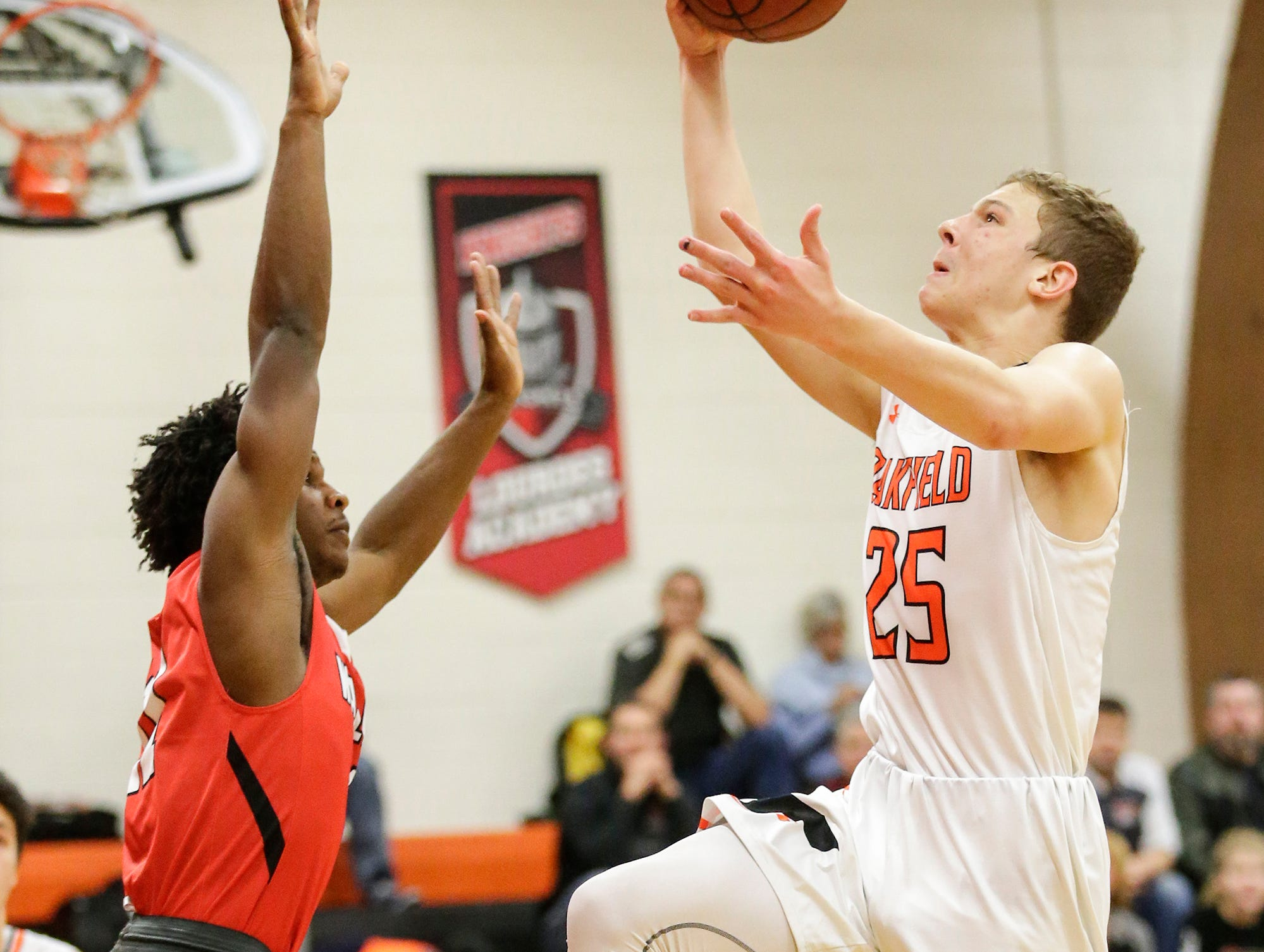 Oakfield High School boys basketball's Grant Bass goes up over Wayland Academy's Charles Eubanks January 11, 2019 during their game in Oakfield. Oakfield won the game 56-48. Doug Raflik/USA TODAY NETWORK-Wisconsin