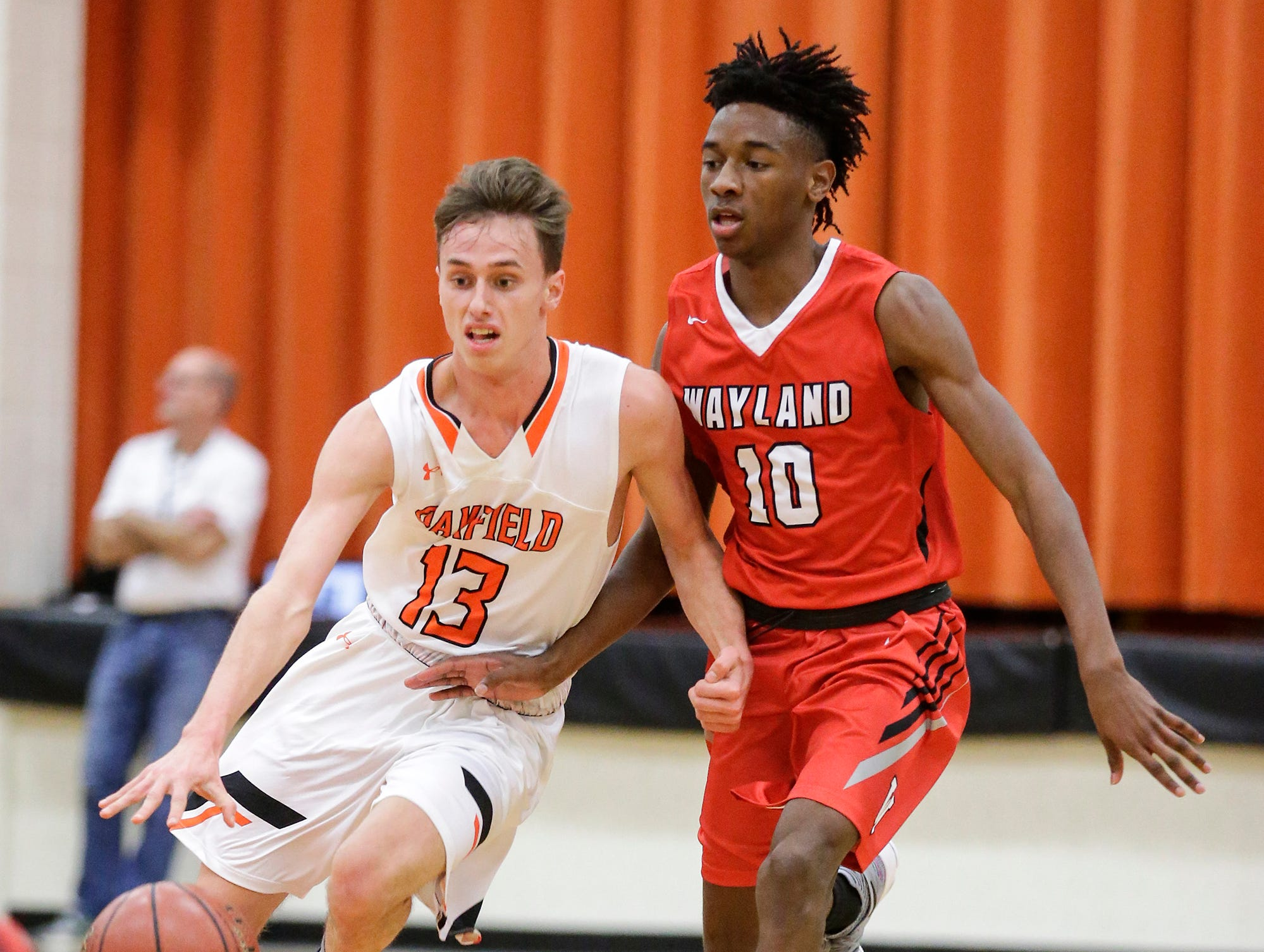 Oakfield High School boys basketball's Tyler Streeter drives down court against Wayland Academy's Issac Eubanks January 11, 2019 during their game in Oakfield. Oakfield won the game 56-48. Doug Raflik/USA TODAY NETWORK-Wisconsin