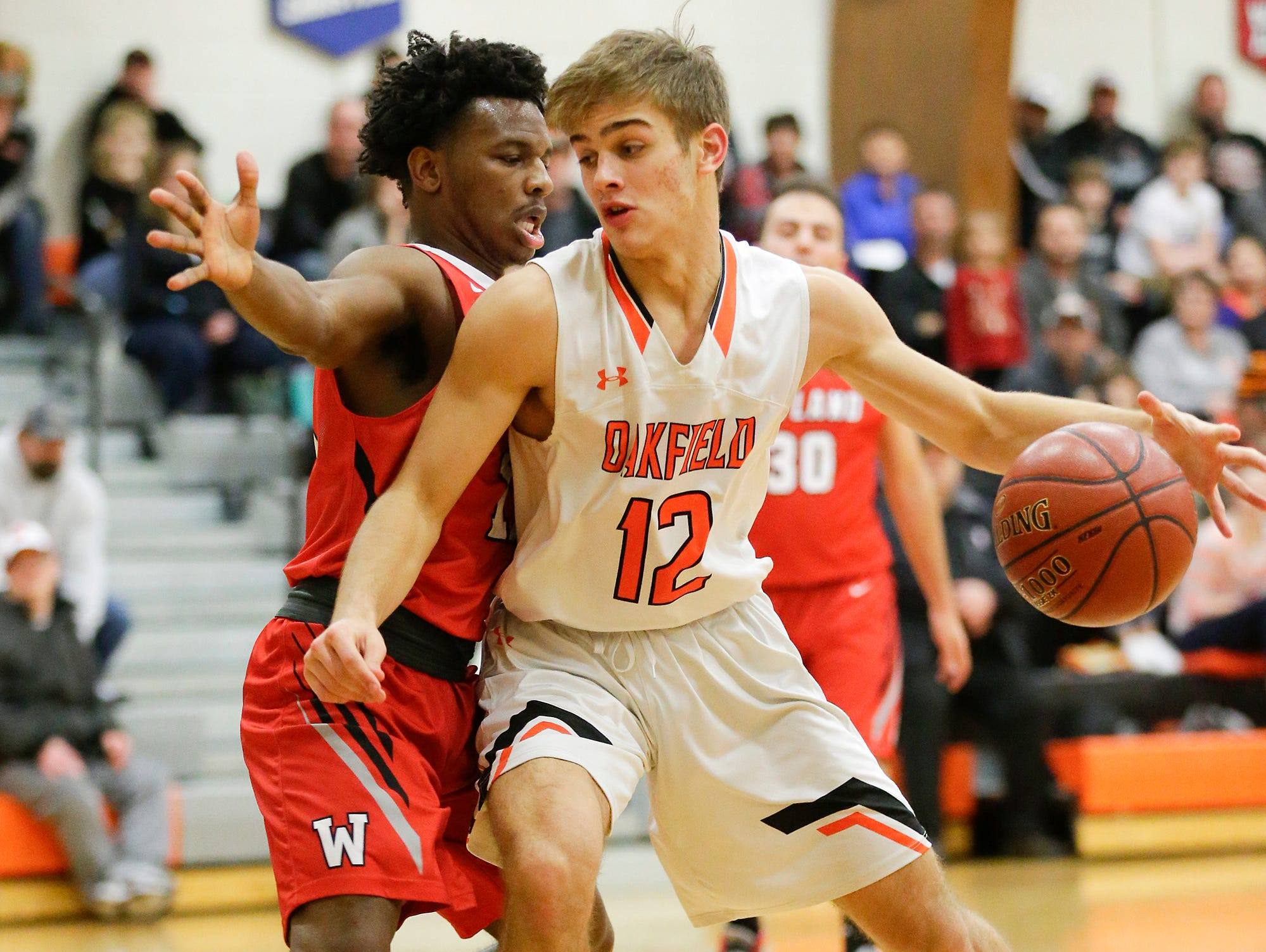 Oakfield High School boys basketball's Zach Seyfert works his way past Wayland Academy's Charles Eubanks January 11, 2019 during their game in Oakfield. Oakfield won the game 56-48. Doug Raflik/USA TODAY NETWORK-Wisconsin
