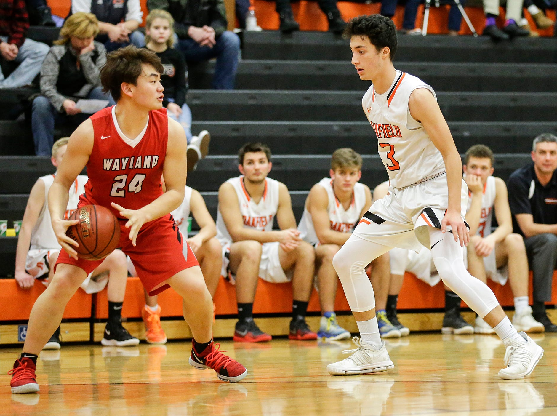 Oakfield High School boys basketball's Jacob Cedar defends against Wayland Academy's Oscar Sun January 11, 2019 during their game in Oakfield. Oakfield won the game 56-48. Doug Raflik/USA TODAY NETWORK-Wisconsin