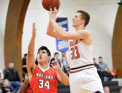 Oakfield High School boys basketball's Bart Bijl attempts a shot against Wayland Academy's Peter Petrakis January 11, 2019 during their game in Oakfield. Oakfield won the game 56-48. Doug Raflik/USA TODAY NETWORK-Wisconsin