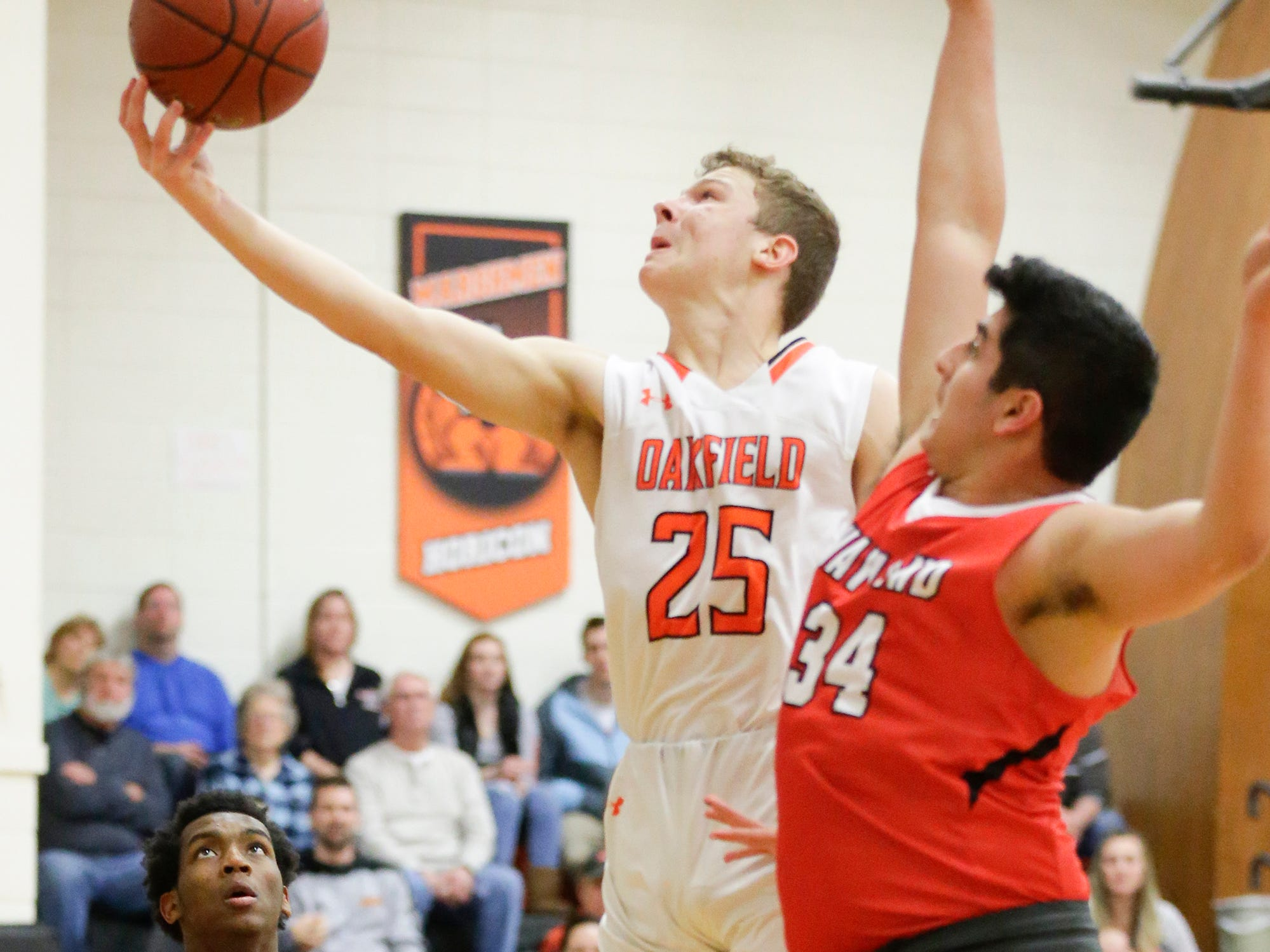 Oakfield High School boys basketball's Grant Bass goes up for a basket against Wayland Academy January 11, 2019 during their game in Oakfield. Oakfield won the game 56-48. Doug Raflik/USA TODAY NETWORK-Wisconsin