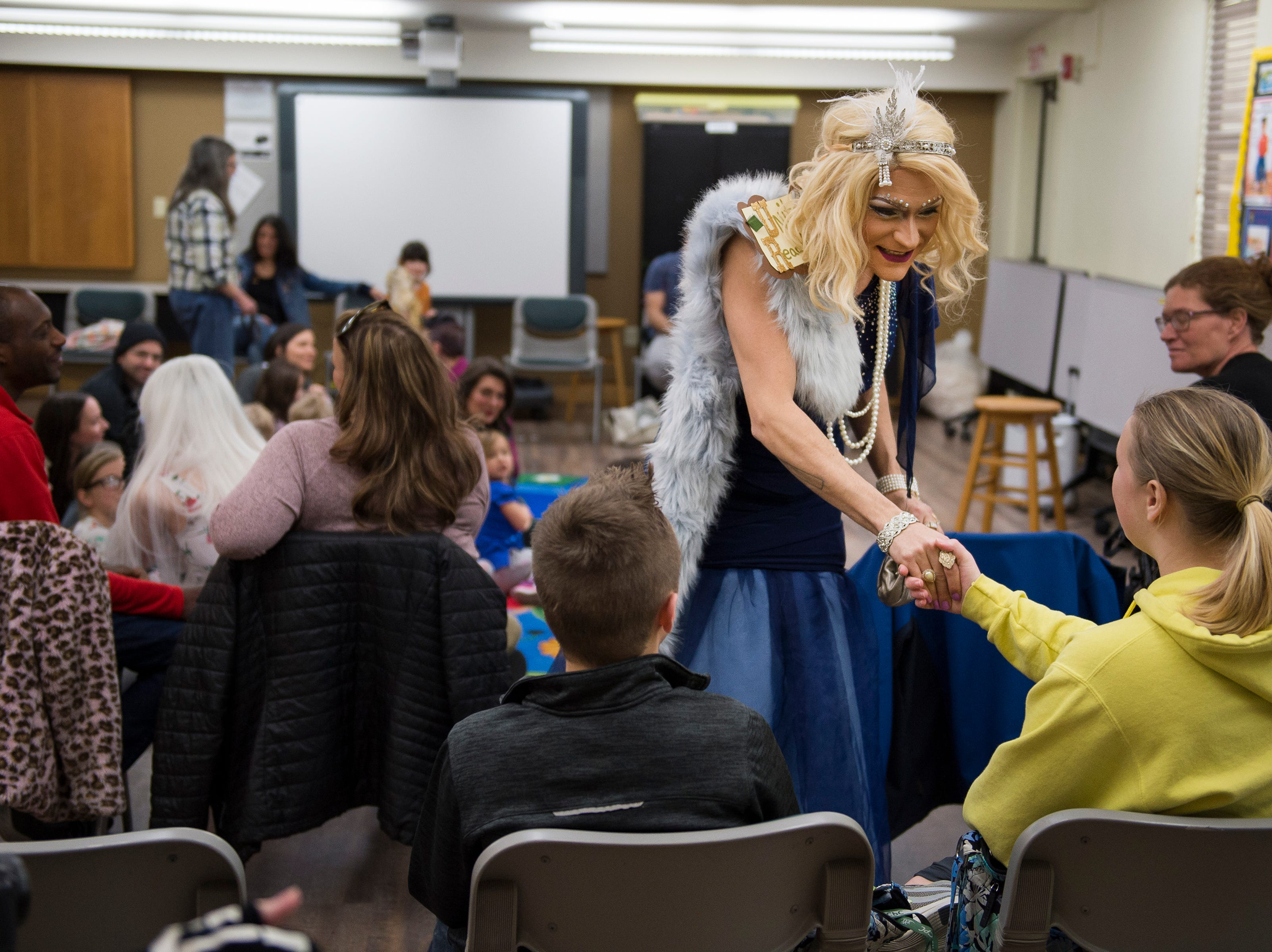 Drag queen Unita ReadMoore greets ticket-holders before Drag Queen Story Hour on Saturday, Jan. 12, 2019, at the Clearview Public Library in Windsor, Colo. Drag Queen Story Hour is a program put on by SPLASH, an LGBTQ+ youth outreach organization.