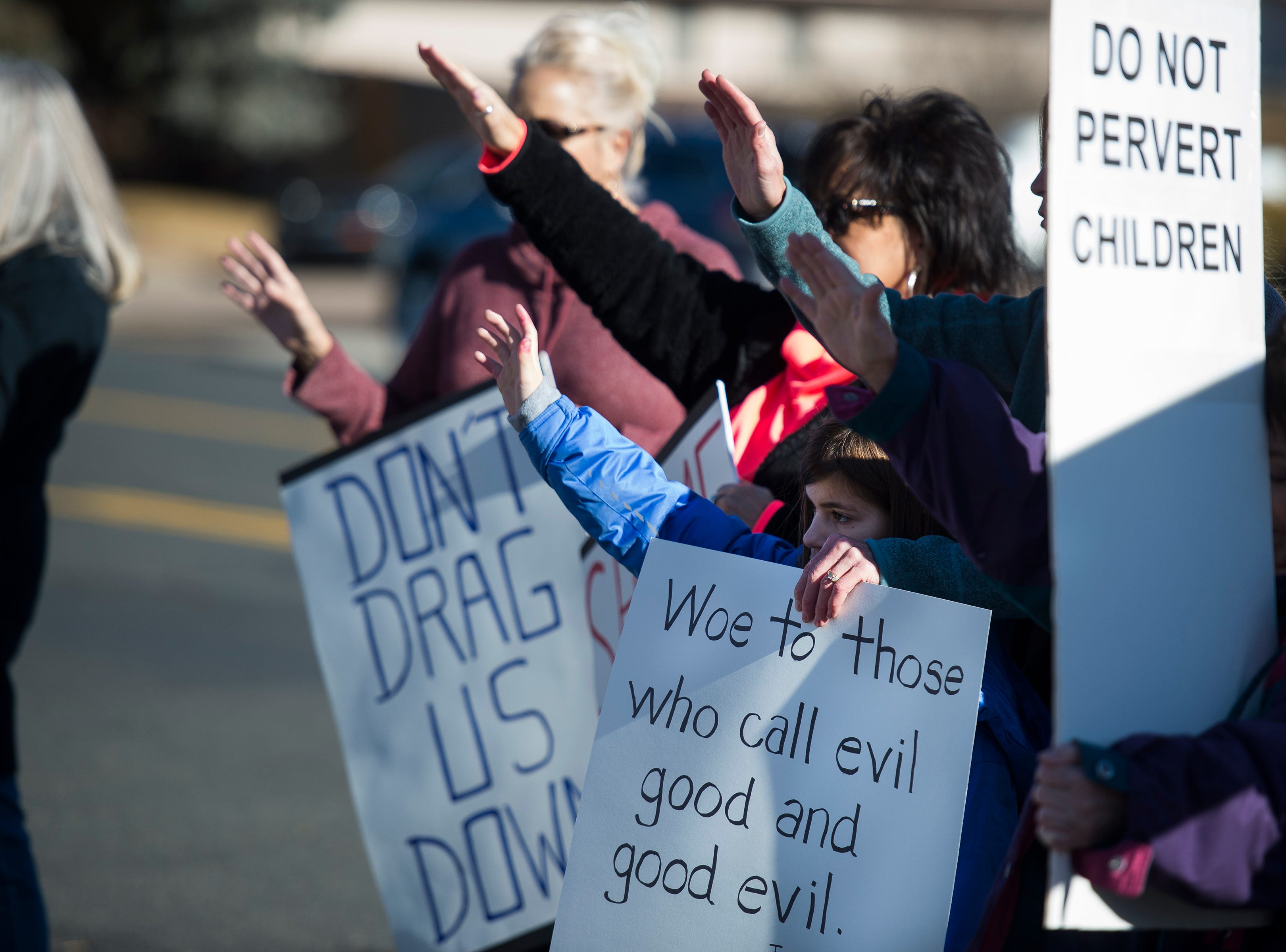 Protesters gather outside the library before Drag Queen Story Hour on Saturday, Jan. 12, 2019, at the Clearview Public Library in Windsor, Colo. Drag Queen Story Hour is a program put on by SPLASH, an LGBTQ+ youth outreach organization.