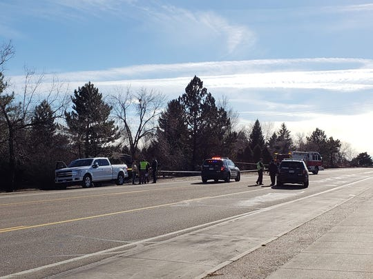 A person who witnessed the fatal truck versus tree crash in southwest Fort Collins speaks to police near the scene Jan. 12, 2018.