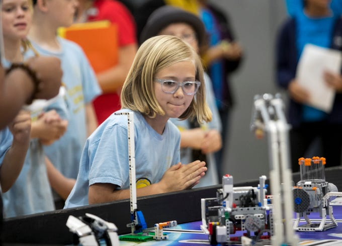 Delaney Baucom of the Assembly Required team from Edison Park Creative and Expressive Arts School watches her teamÕs robot closely during the Cypress Lake First LEGO League Qualifying Tournament at Cypress Lake Middle School in Fort Myers on Saturday, January 12, 2019.