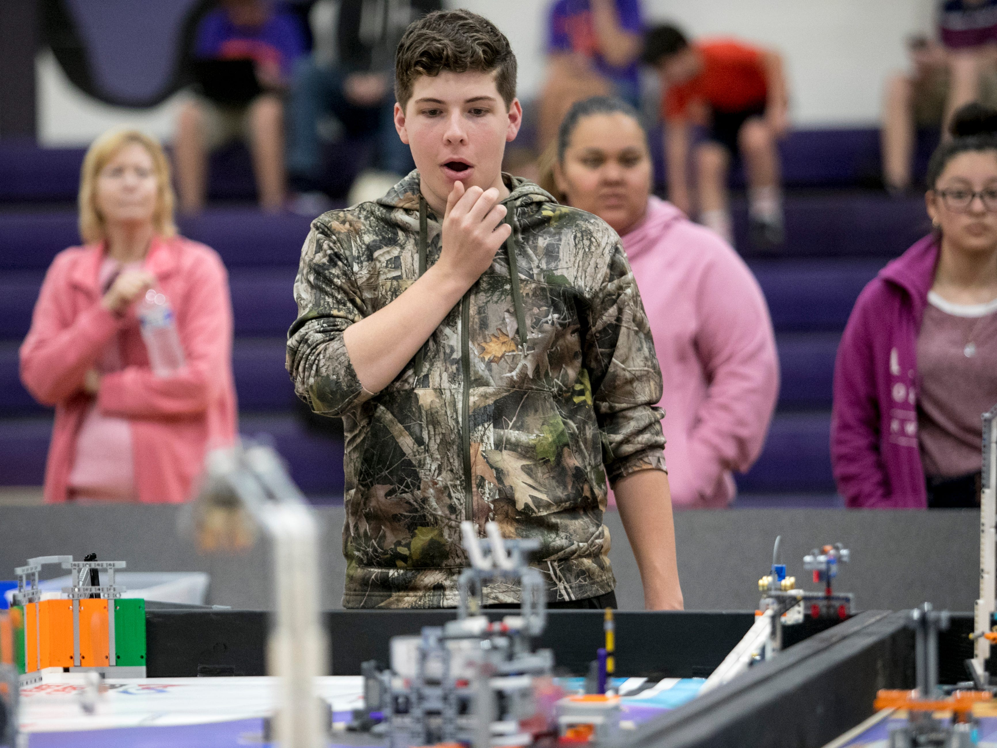 Justin Sherrod and the LaBelle Middle School Techno Waffles team reacts during the Cypress Lake First LEGO League Qualifying Tournament at Cypress Lake Middle School in Fort Myers on Saturday, January 12, 2019.